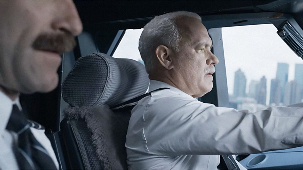 Strong directing, cinematography, performances, editing, and score are all high points of  Sully, making it just as much of a popcorn-muncher as a sweeping drama. (Warner Bros.)