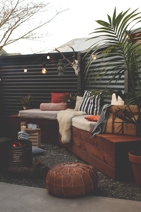 Use cushions, lighting and blankets to make an outdoor space more comfortable in winter. Image via  Blackbird .