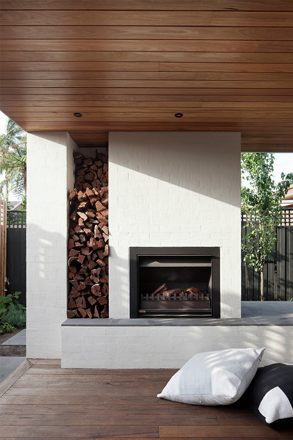 When planning a built-in fireplace, think about where you will store your firewood too. Image via  Gardenista .