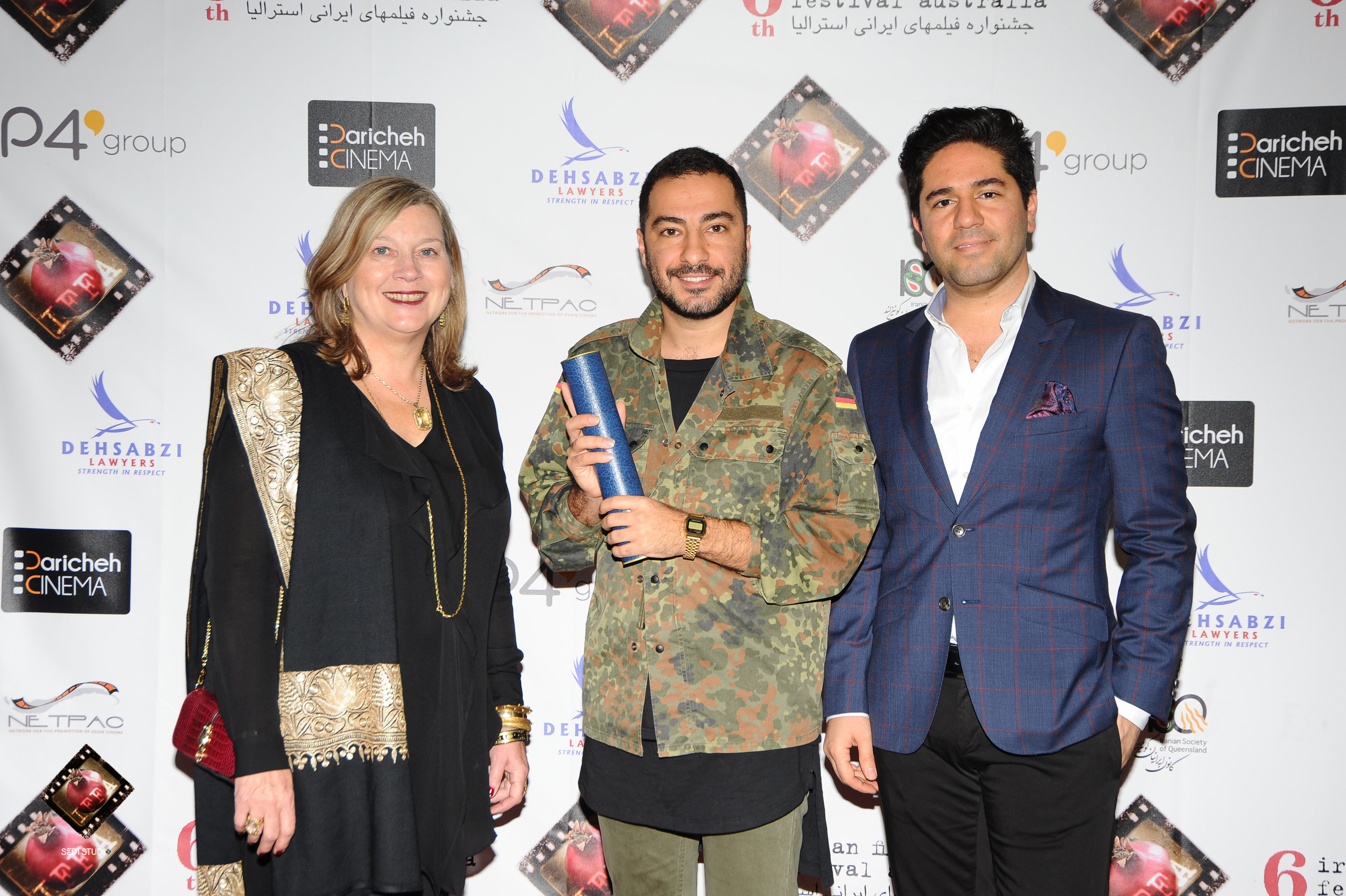 Actor Navid Mohammadzadeh accepting on behalf of Saeed Roostaee