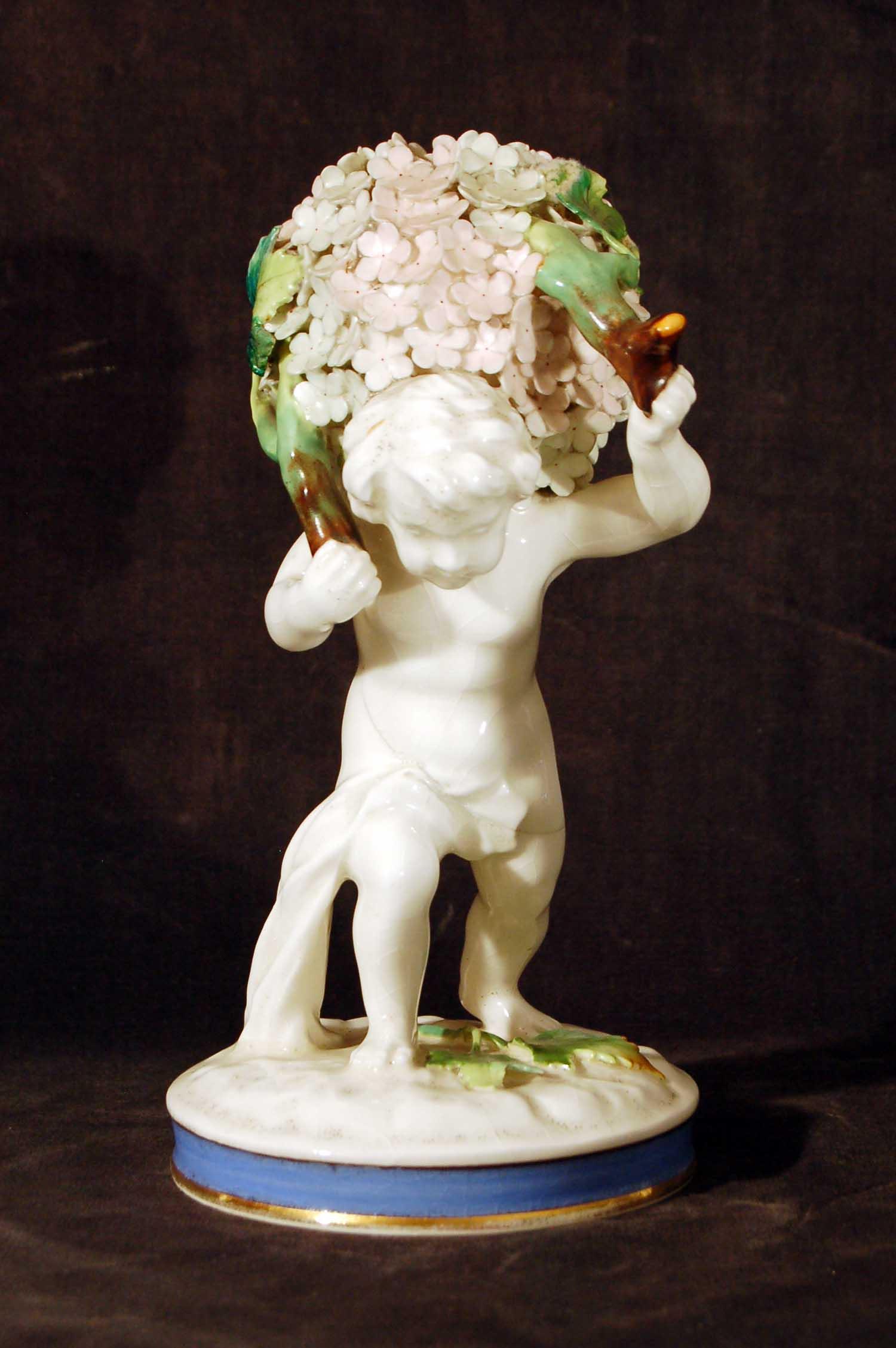 """Porzellanfigur """"Blumenträger"""", glasiert, ohne Marke, wohl Österreich um 1910, Höhe 20cm"""