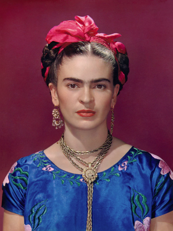 Frida Kahlo in blue satin blouse, 1939. © Nickolas Muray Photo Archives.