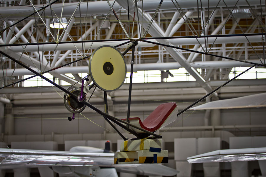 Pilot's seat hung from the truss with carbon tubes and bracing wire on the sides.