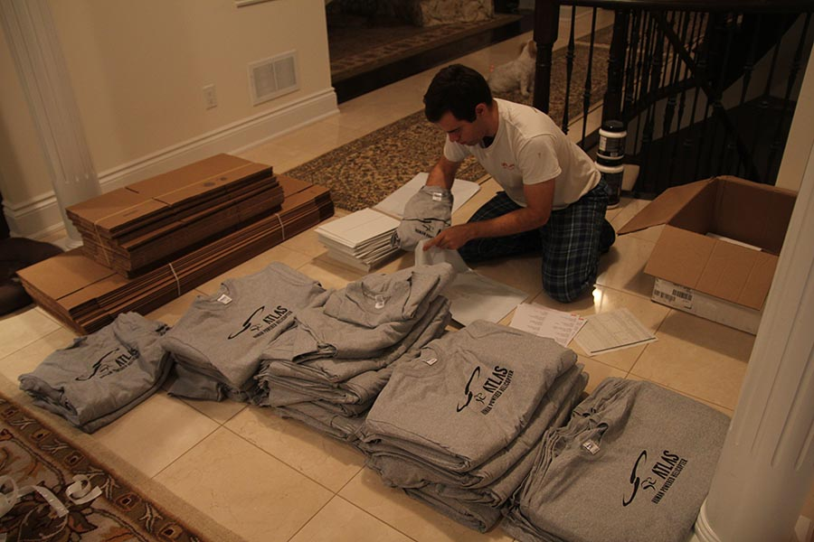 Cameron packing the Atlas t-shirts.