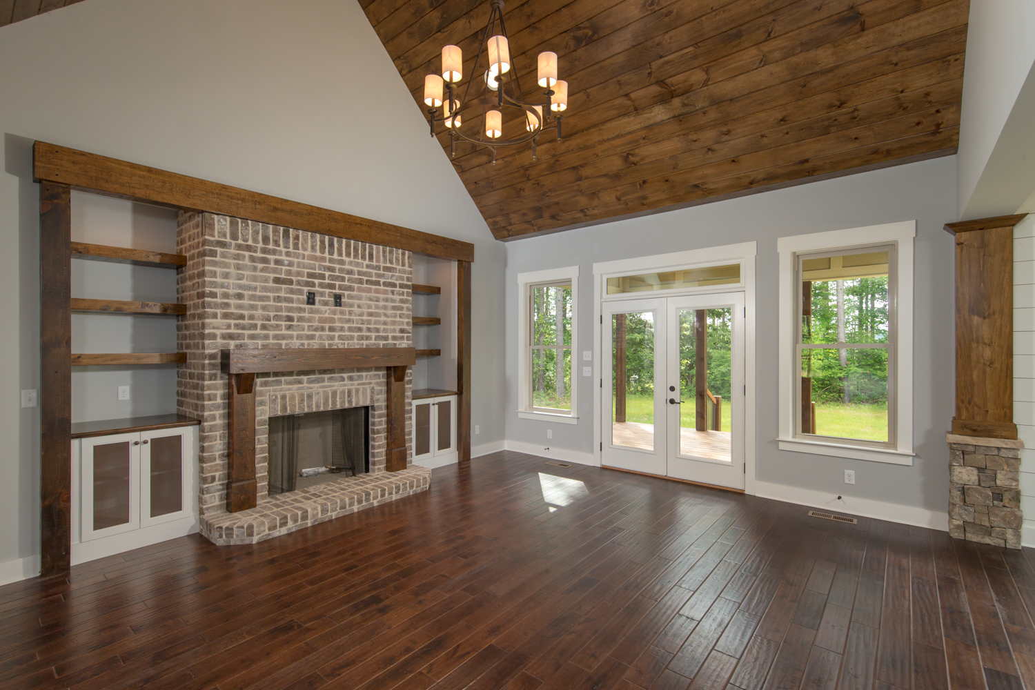 open living room with vaulted ceiling