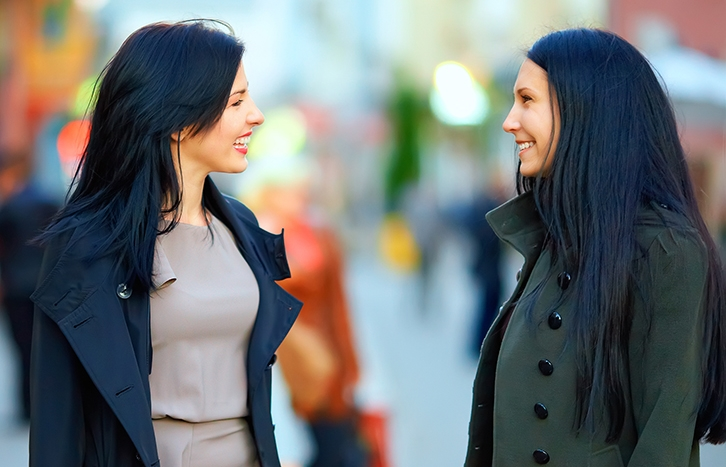 bigstock-Two-Happy-Women-Talking-On-Cro-44483743-LZ.jpg