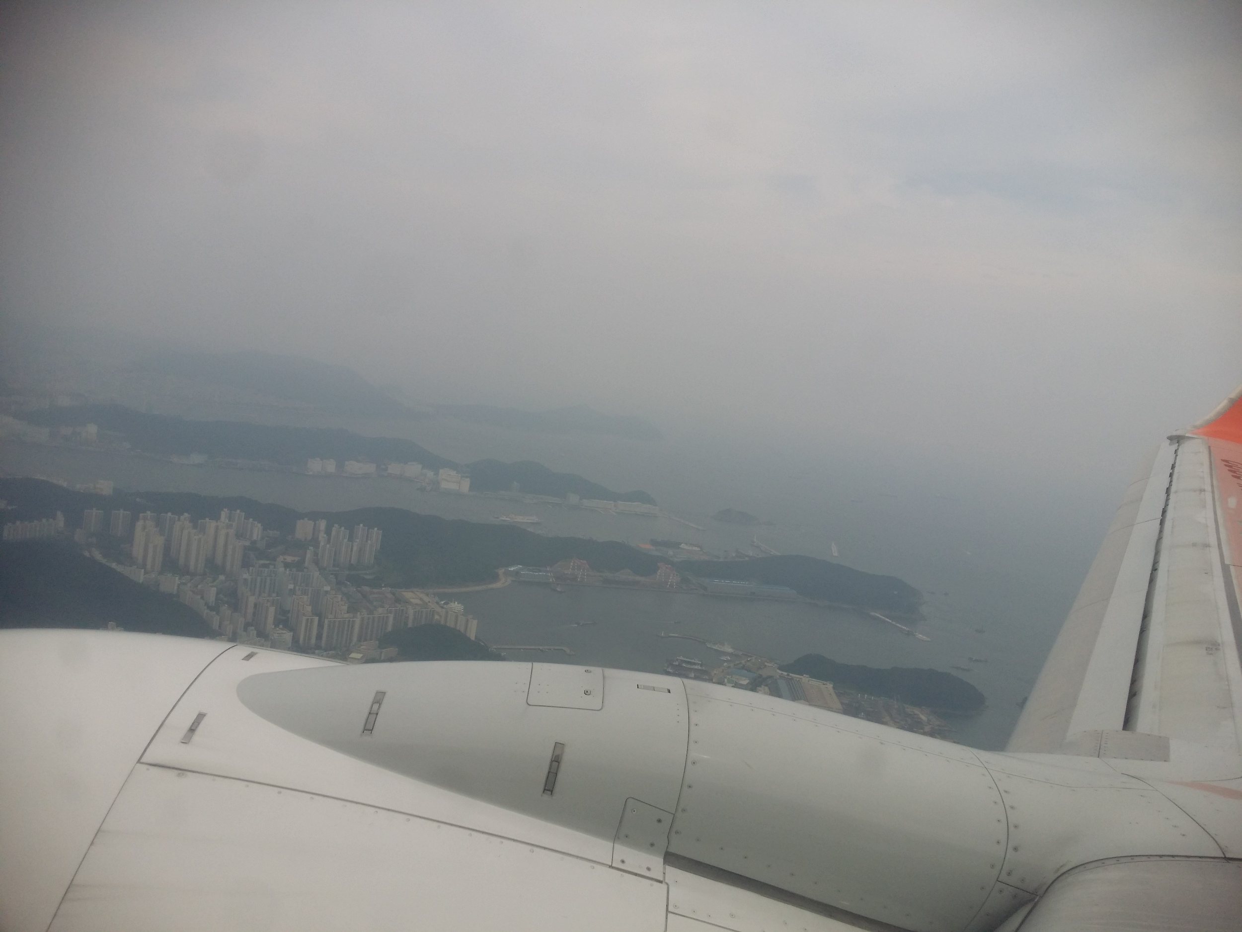Flying with Jeju Air over a cloudy Korea