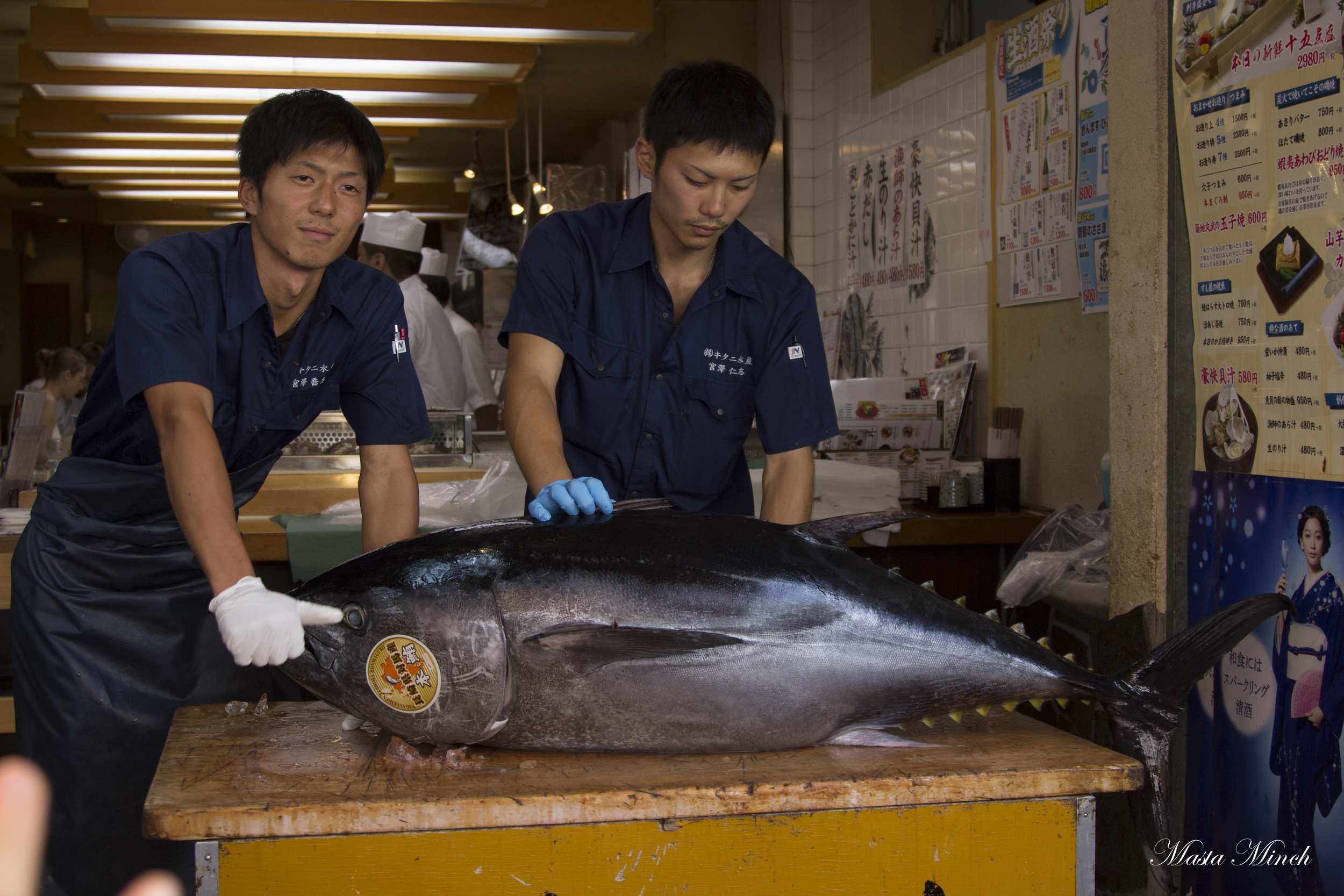 These guys showing off their tuna they bought from the auction house in the morning