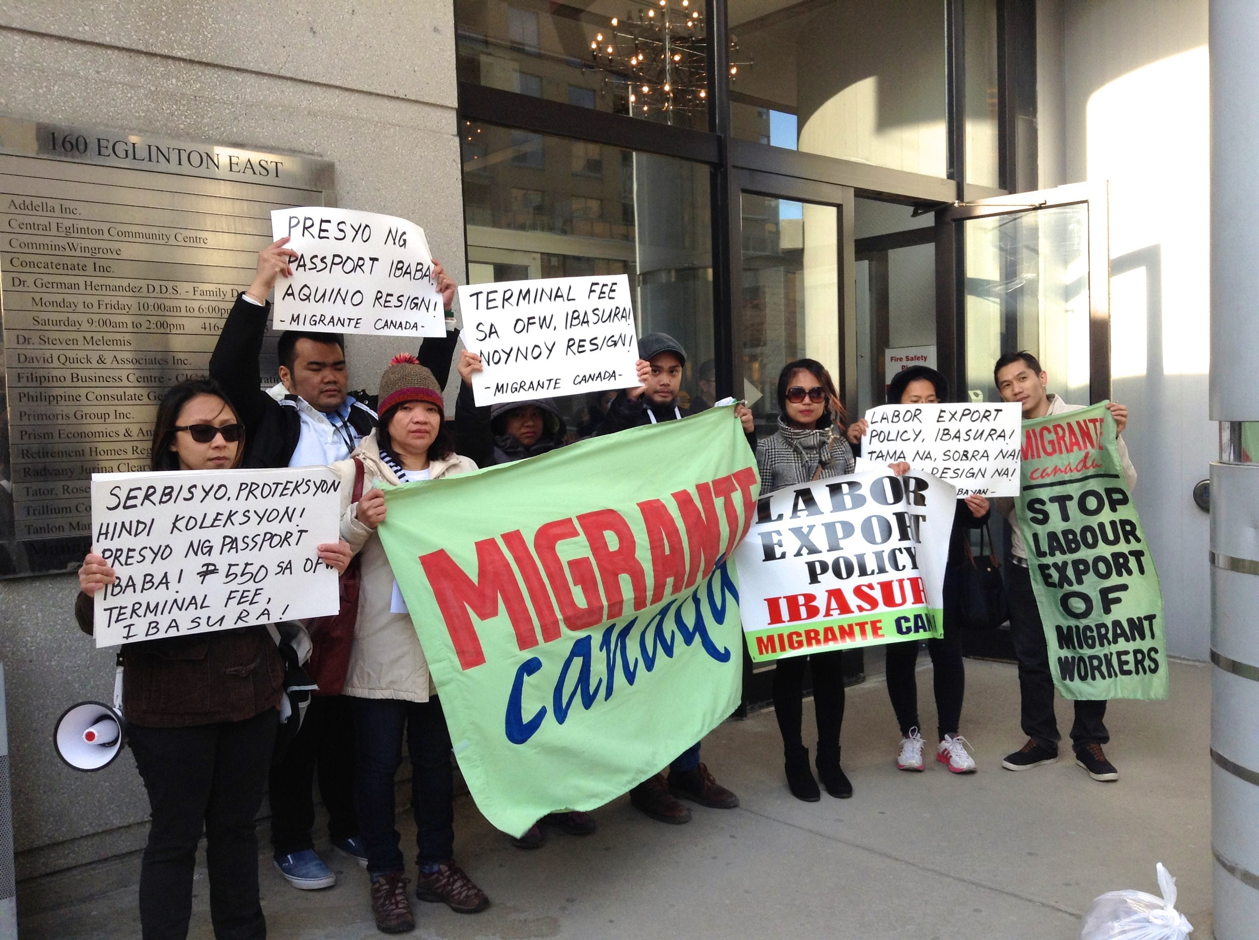 Representatives from Migrante Ontario, iWWorkers, Gabriela Canada, and Anakbayan Toronto rallying outside of the Philippine Consulate.