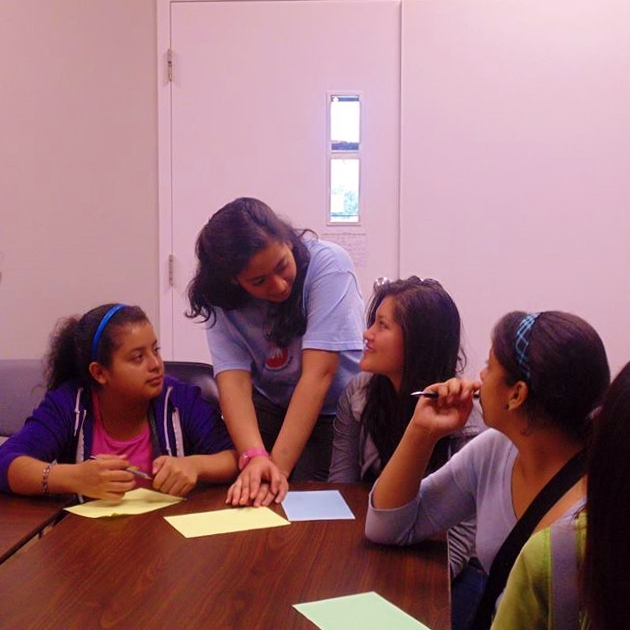 Former newcomer student Farrah Mansoor introduces herself to fellow Madonna CSS students. Photo by Mareena Ismail.
