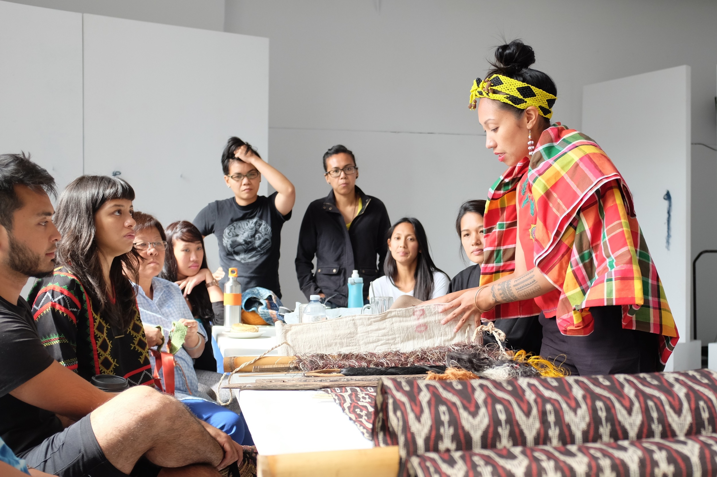 Jennifer Maramba teaching about the T'nalak, a T'boli textile. Photo by J. Austria