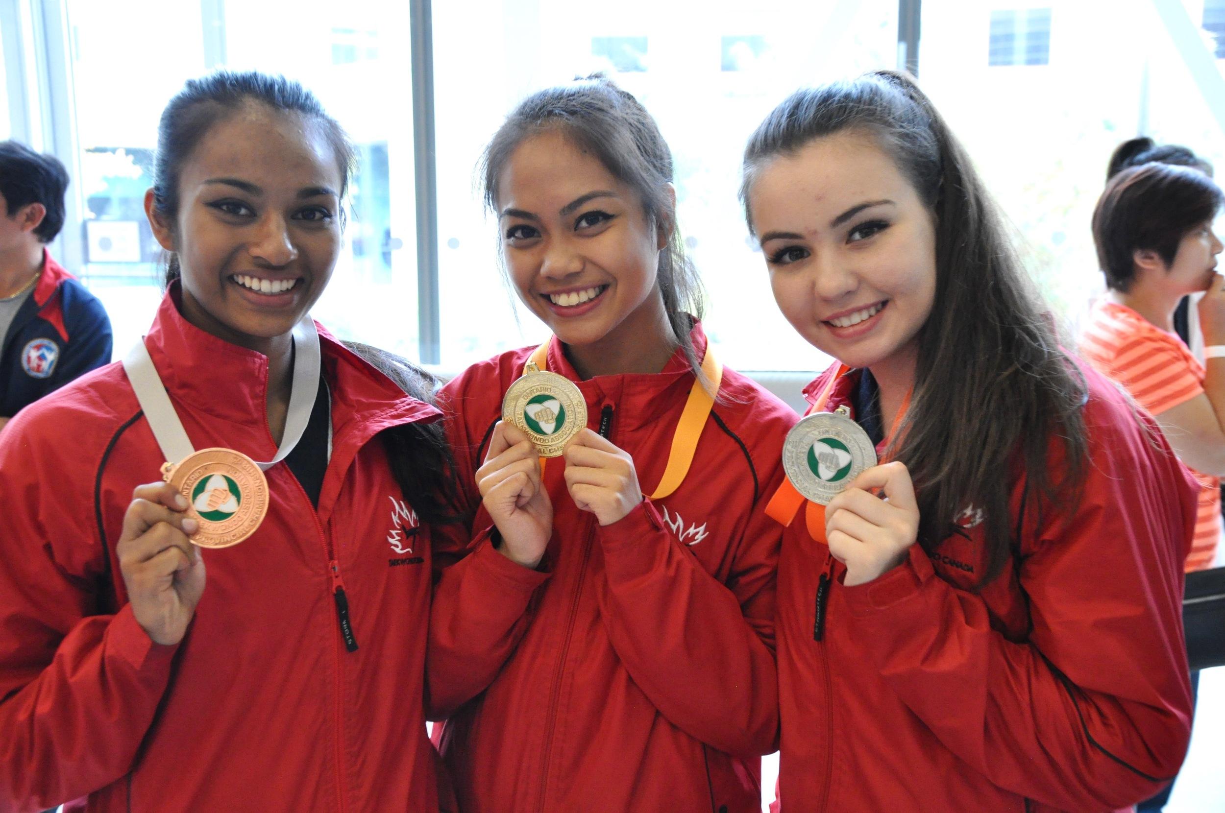 Dela Cruz (centre) with teammates at the Ontario Provincial Poomsae Championship. Photo by Alvin Dela Cruz