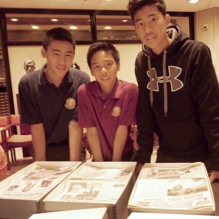 St. Michael's Choir School students   David, Daniel and Jai Avila view The Philippine Reporter's archived collection. Photo by Mila Astorga Garcia