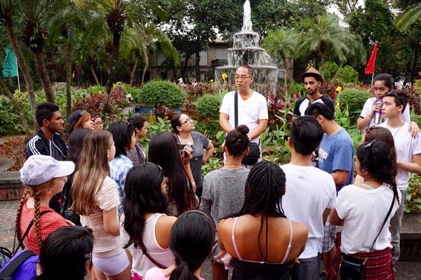 Consul's father Bernie gives students a Philippine history lesson at Fort Santiago. Photo by Catholic Student Leadership
