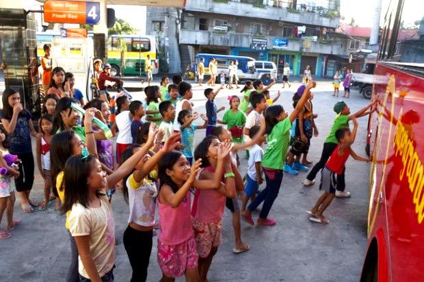 Children waving goodbye to the TCDSB students. Photo by Catholic Student Leadership