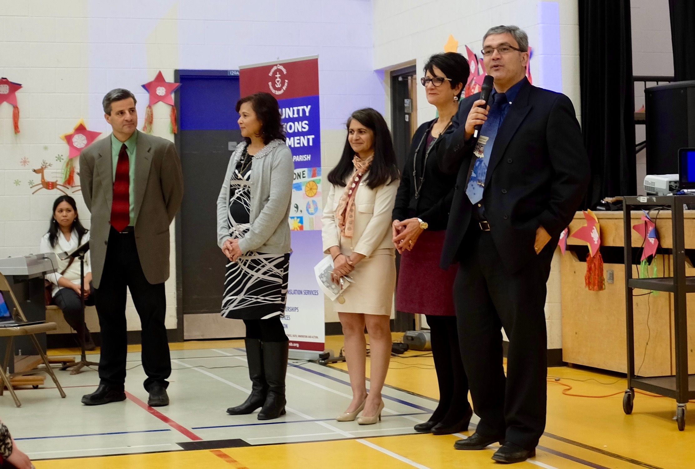 """Principals from five TCDSB elementary schools address the crowd: """"It's so important that we are welcomed into your family and you are welcomed into ours."""""""