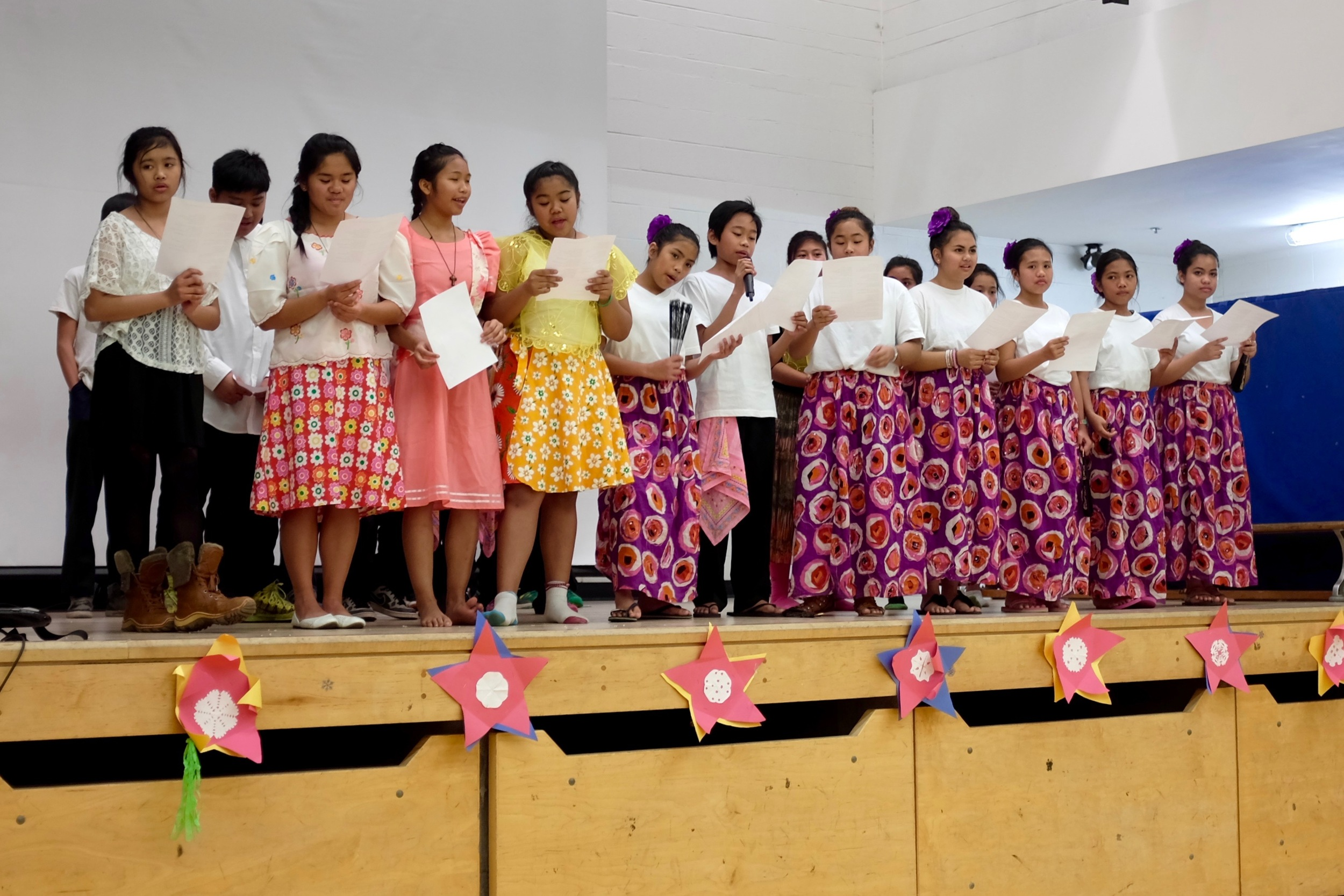 Students perform traditional Philippine Christmas songs.