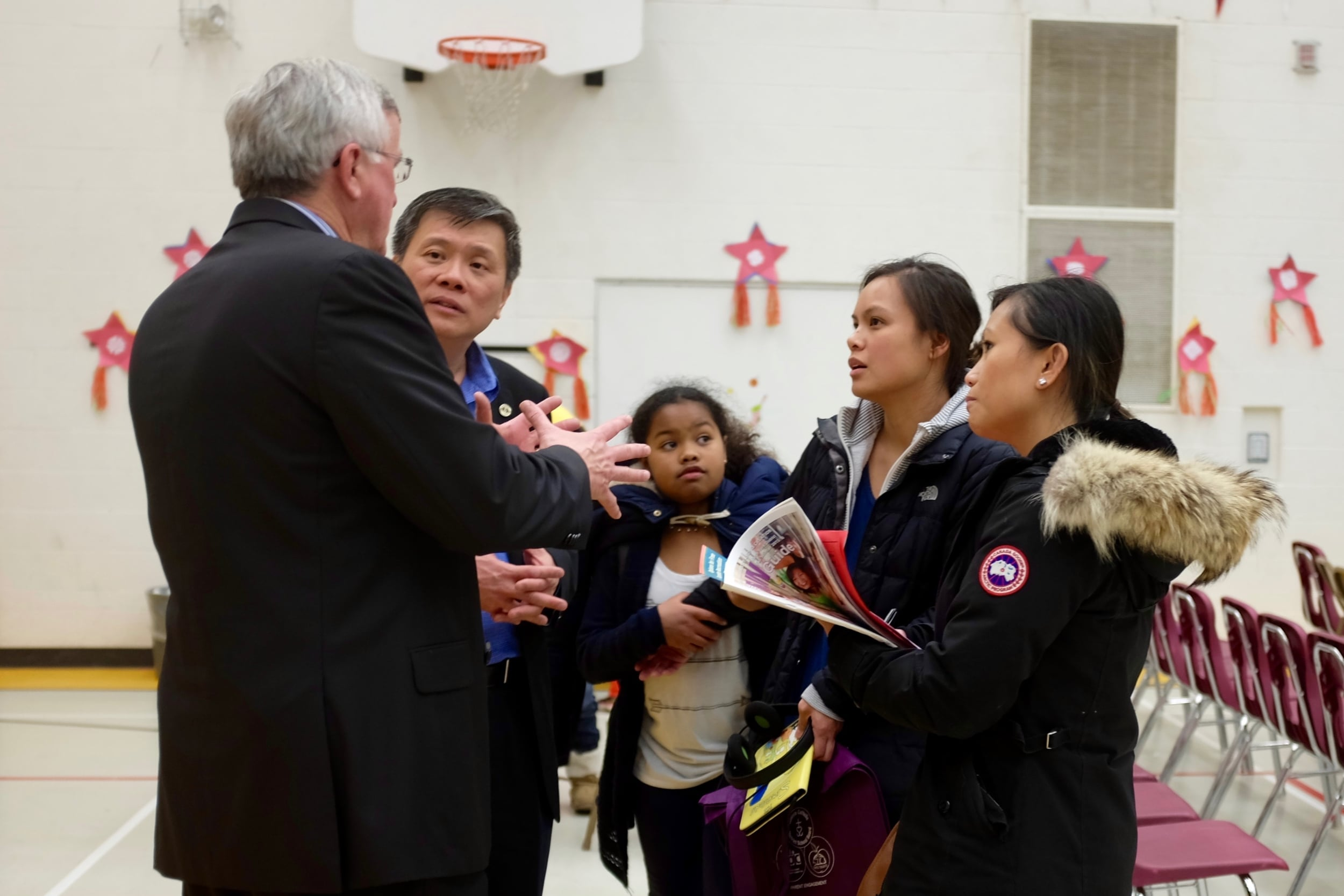 Superintendent John Shain speaks with Trustee Gerry Tanuan, Jerrylyn Gueverra and Judith Cortez at a TCDSB Filipino Christmas event.