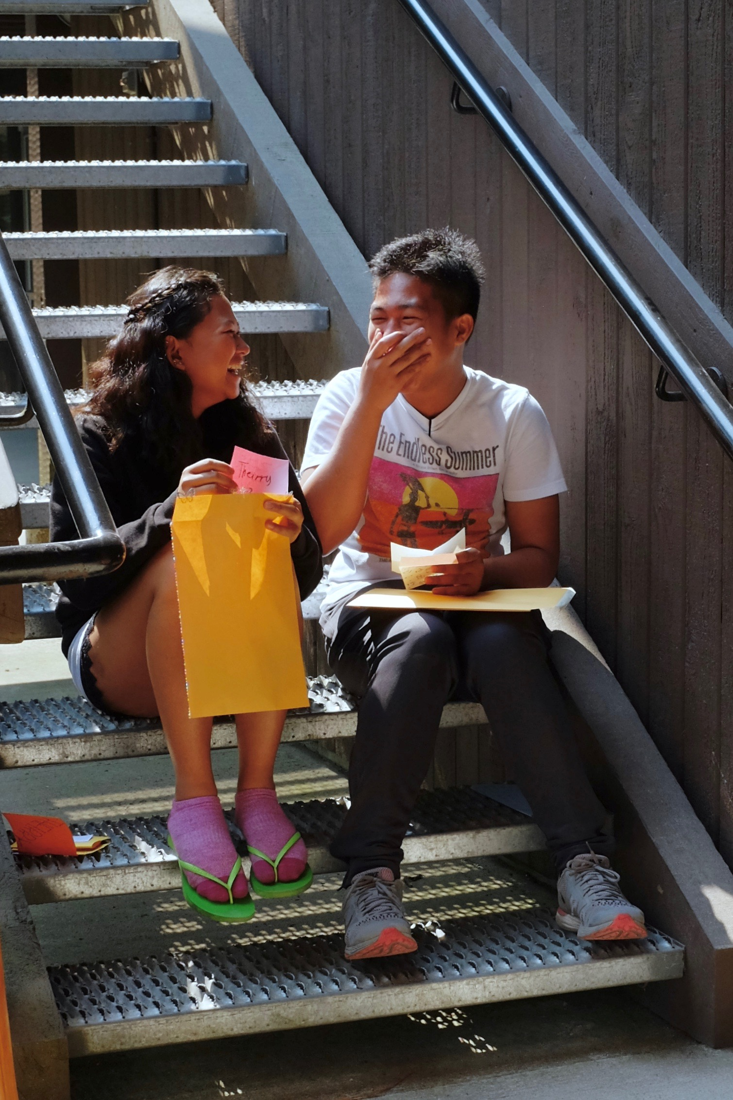 Campers Theirry Mae Mogato and Jomar Calayan laughing over their Palanca letters. Photo by J. Austria.