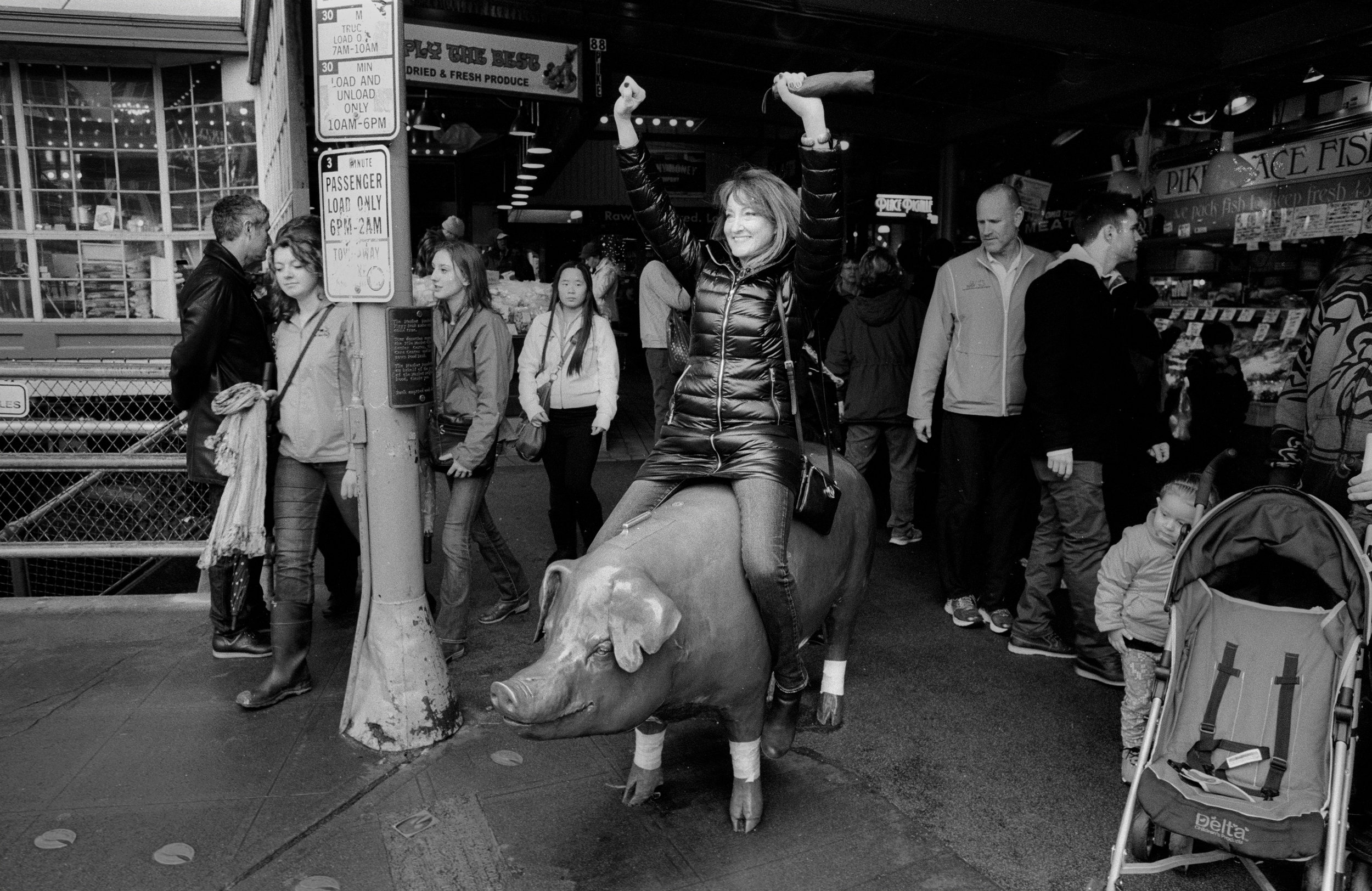 Woman on pig.jpg