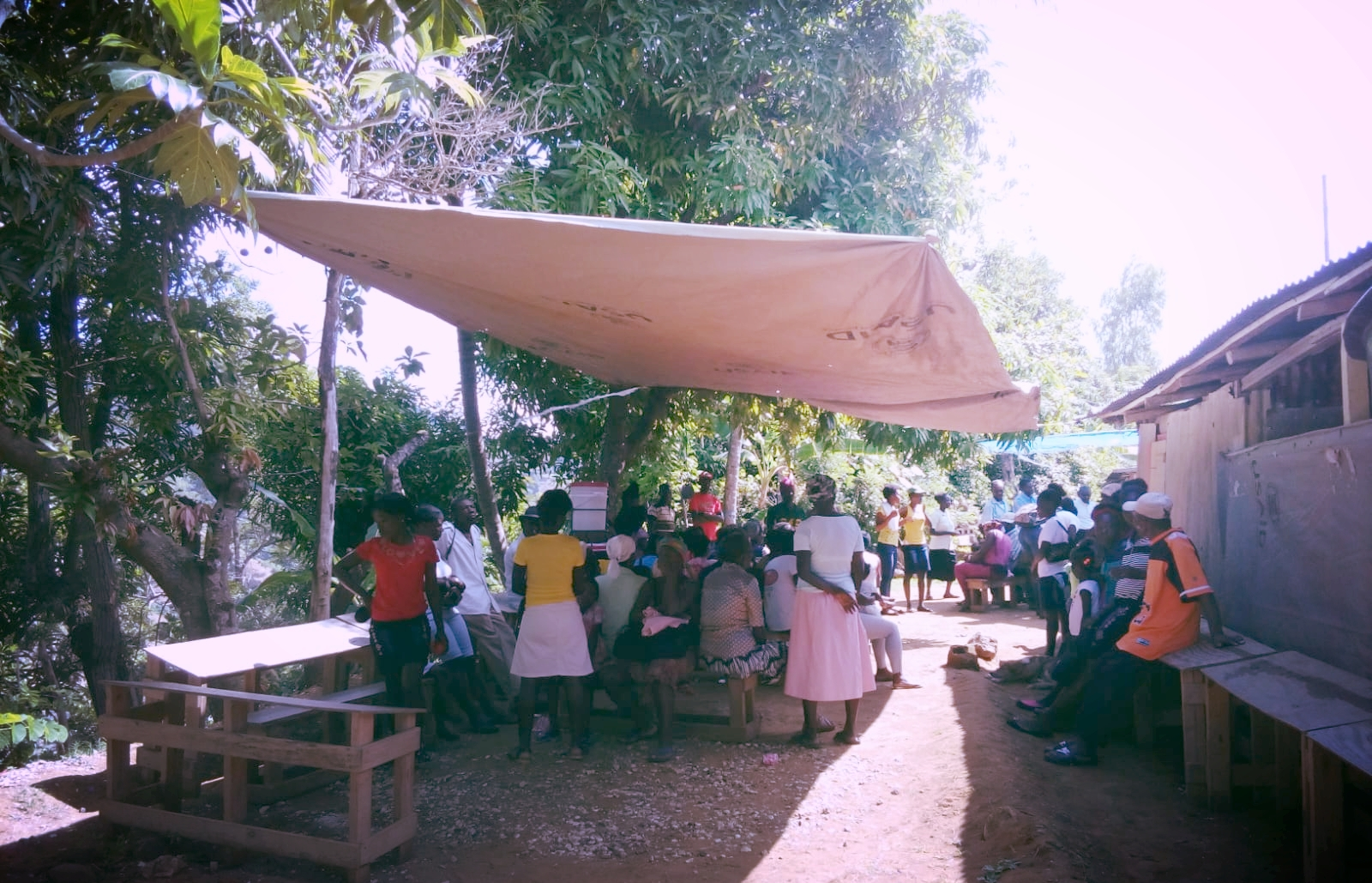 Community members wait for a consultation at a mobile clinic in the mountains of Leogane. For many, attending this mobile clinic is their sole access to healthcare.