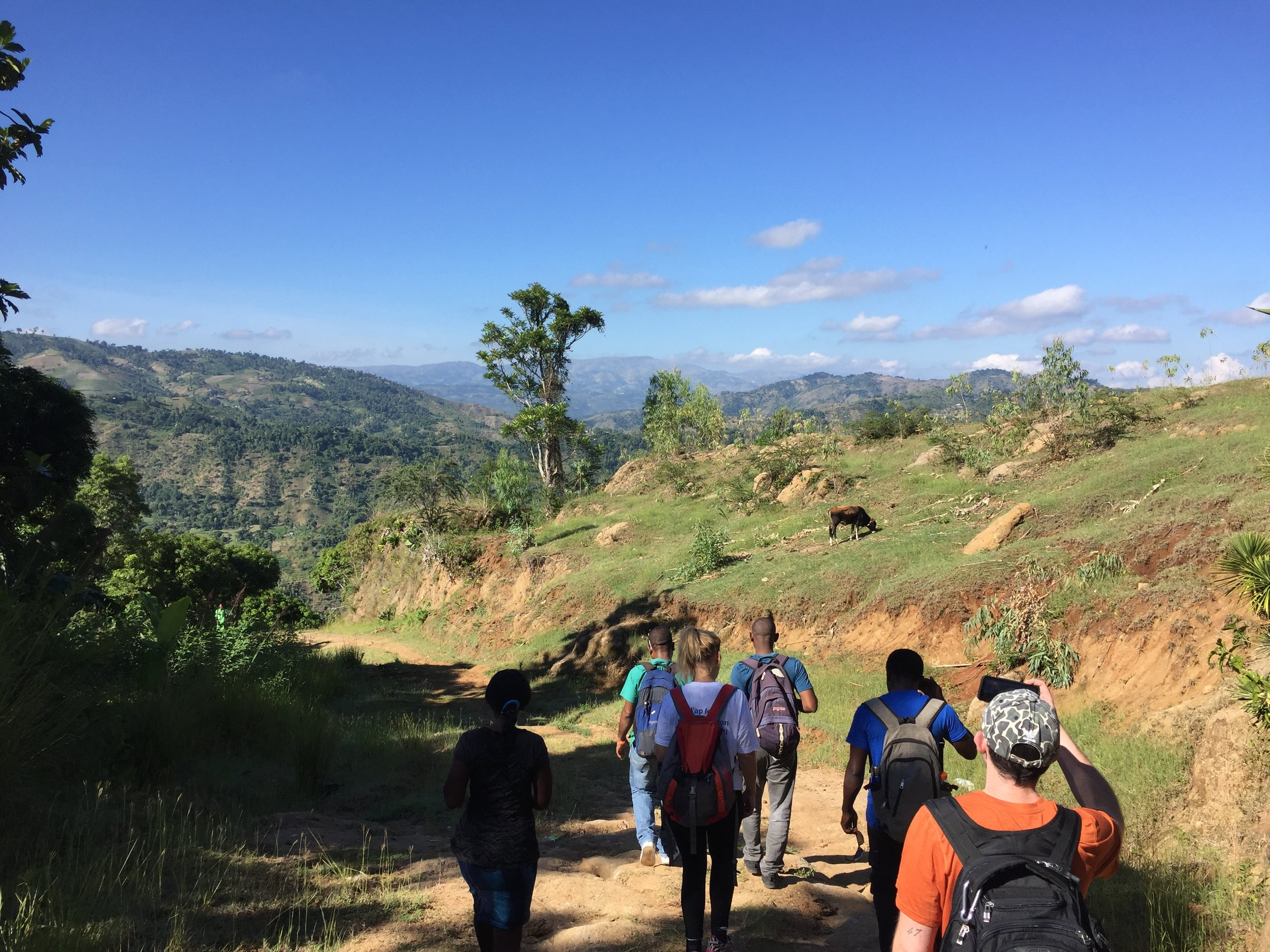 The Kore Timoun team, interpreters, and health practitioners hike to the village where they will setup the mobile clinic for the day