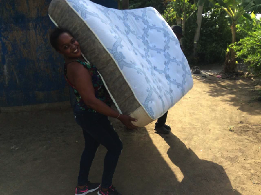 Bébé, our Patient Advocate, delivering a new bed