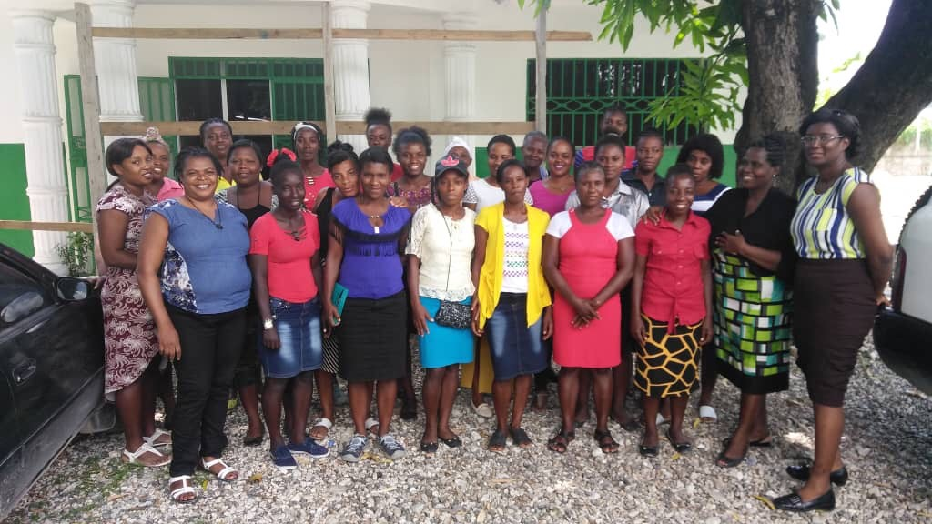 A group of our monitrices with Rose Elene (third from left) and Nurse Martha and Nurse Guirlene (right) of the MOH