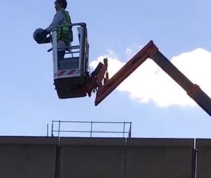 SPS member David Perryman prepares to toss a pumpkin from a 60 ft high cherrypicker