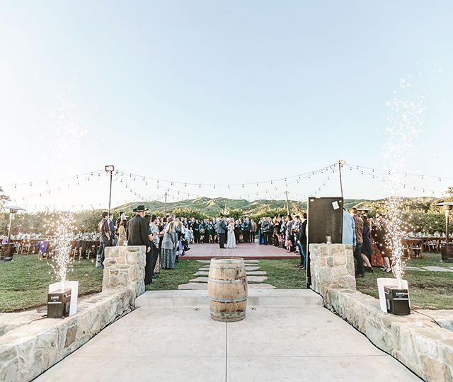Throw back to the spring when the hills were green and the sky was clear and you didn't sweat to death! Oh and check out those sparklers for Kate and Jeff's grand entrance!! Amazing vendor team:  Venue | @limoneiraco  Catering | @platedevents  Rentals | @venturarental  Coordination | @eventsbyashleyw  Dj & Mc | @bruce_barrios  Flowers | @tangledlotus