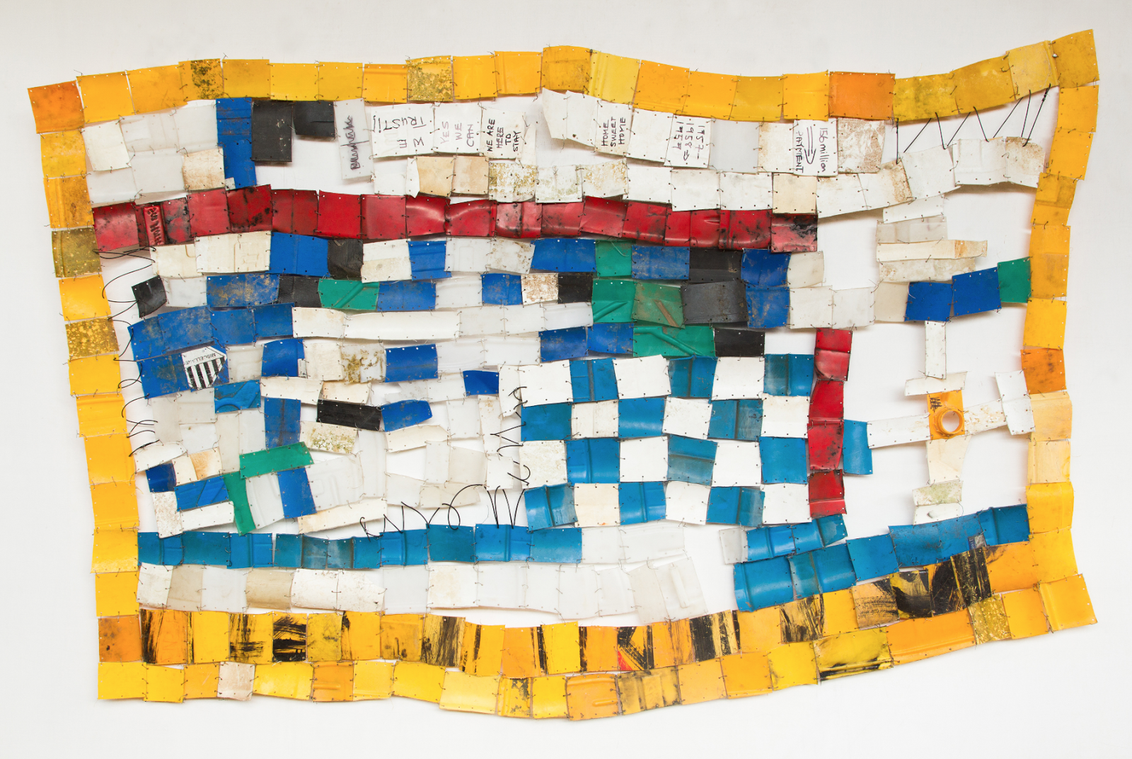 Serge Attukwei Clottey,  American Lottery , 2015, plastic, wire and oil paint, 51 x 94 in.