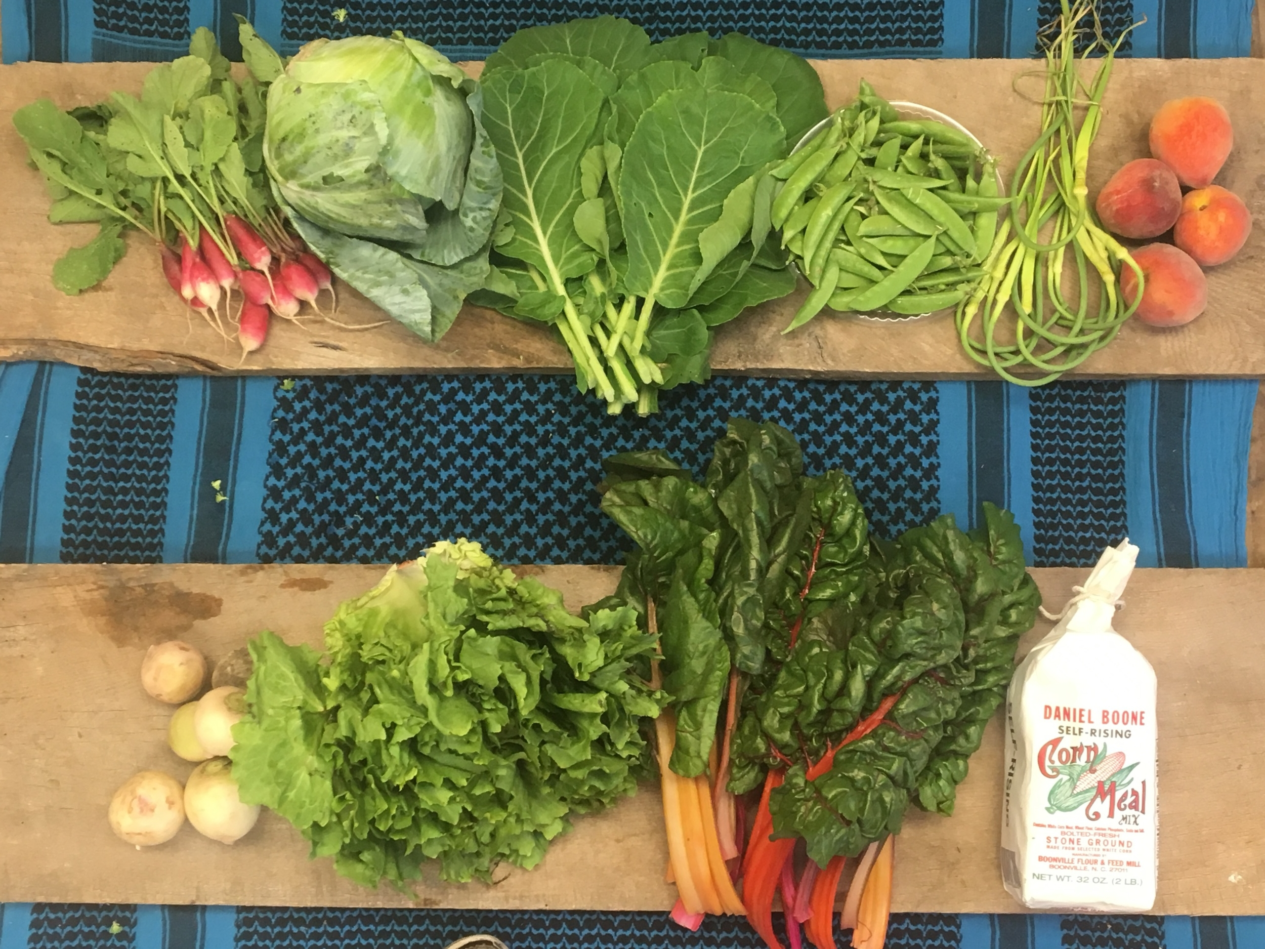 Southern Comfort Family~ French breakfast radishes, Green cabbage, Grab bag (Collards shown. Also available, borage, yellow squash, nasturtiums, dandelion greens, or greasy beans.) snap peas, garlic scapes, peaches, watermelon radishes, escarole, swiss chard, and Daniel Boone cornmeal.