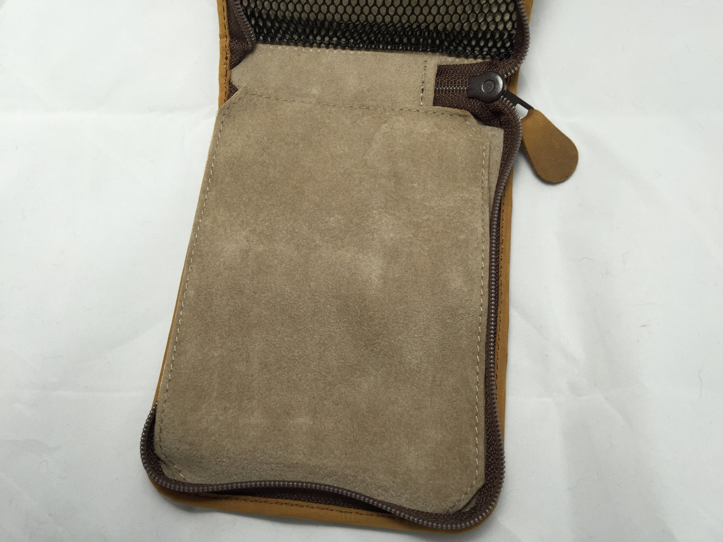 The flap lays off-center, to the left, even when pulled tight without pens in the case.
