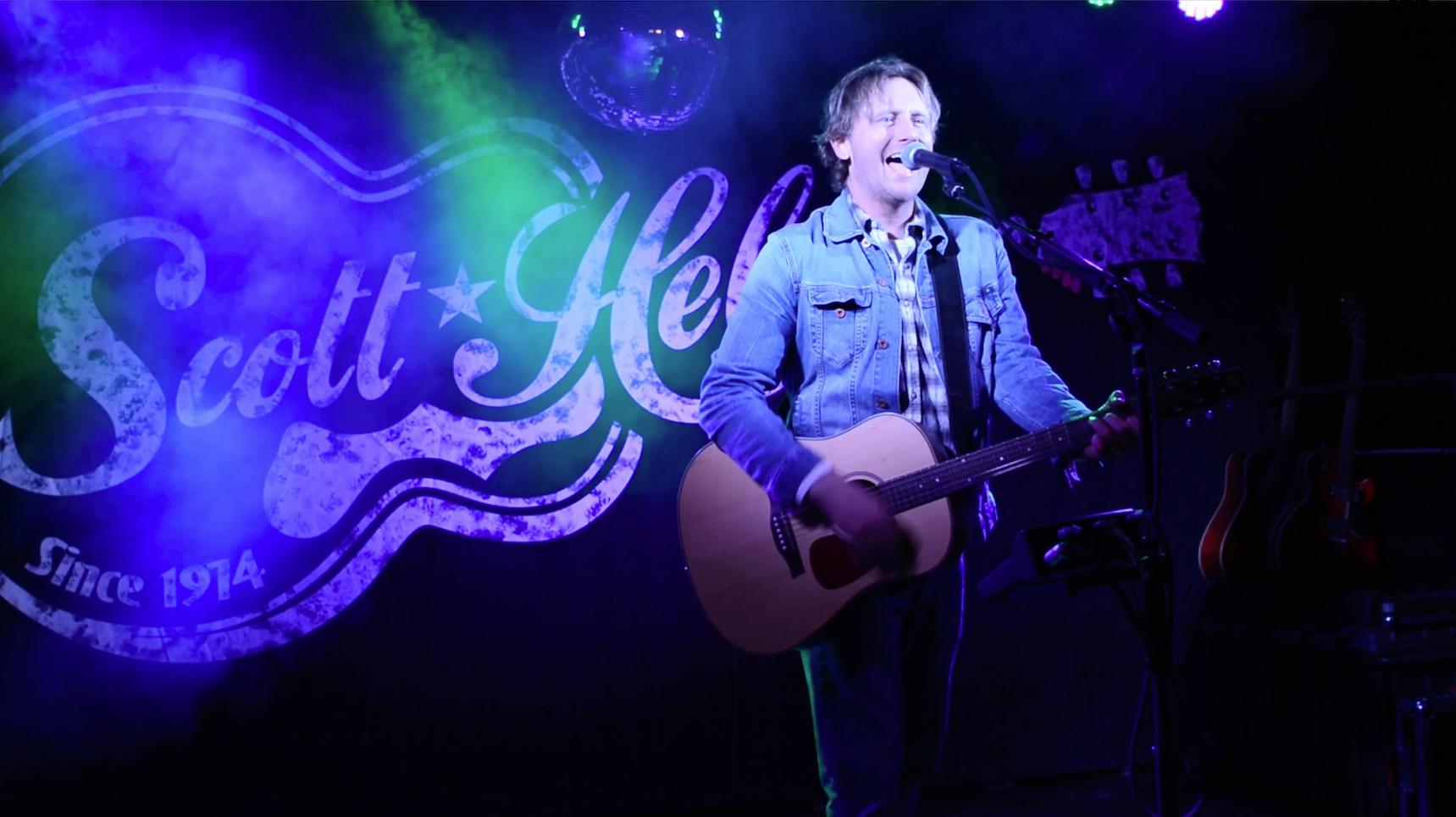 Scott Helmer live on stage.