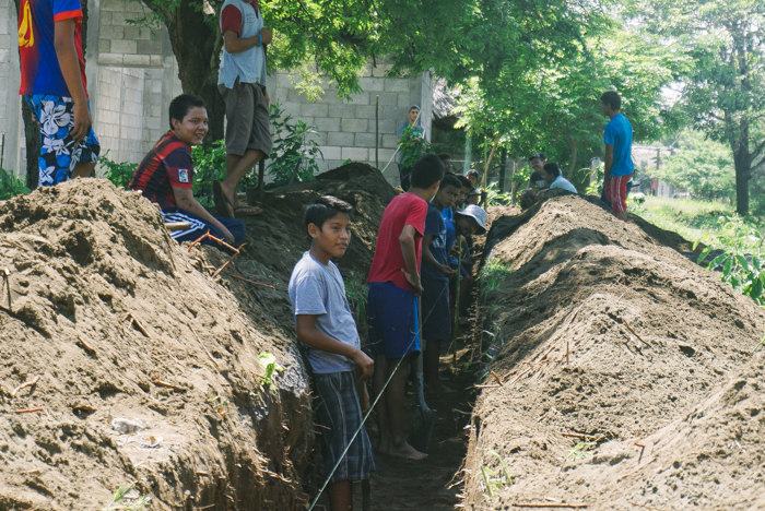 The children of El Paredon were so excited that their new school building was finally being finished that they decided to jump in and dig the ditch themselves.