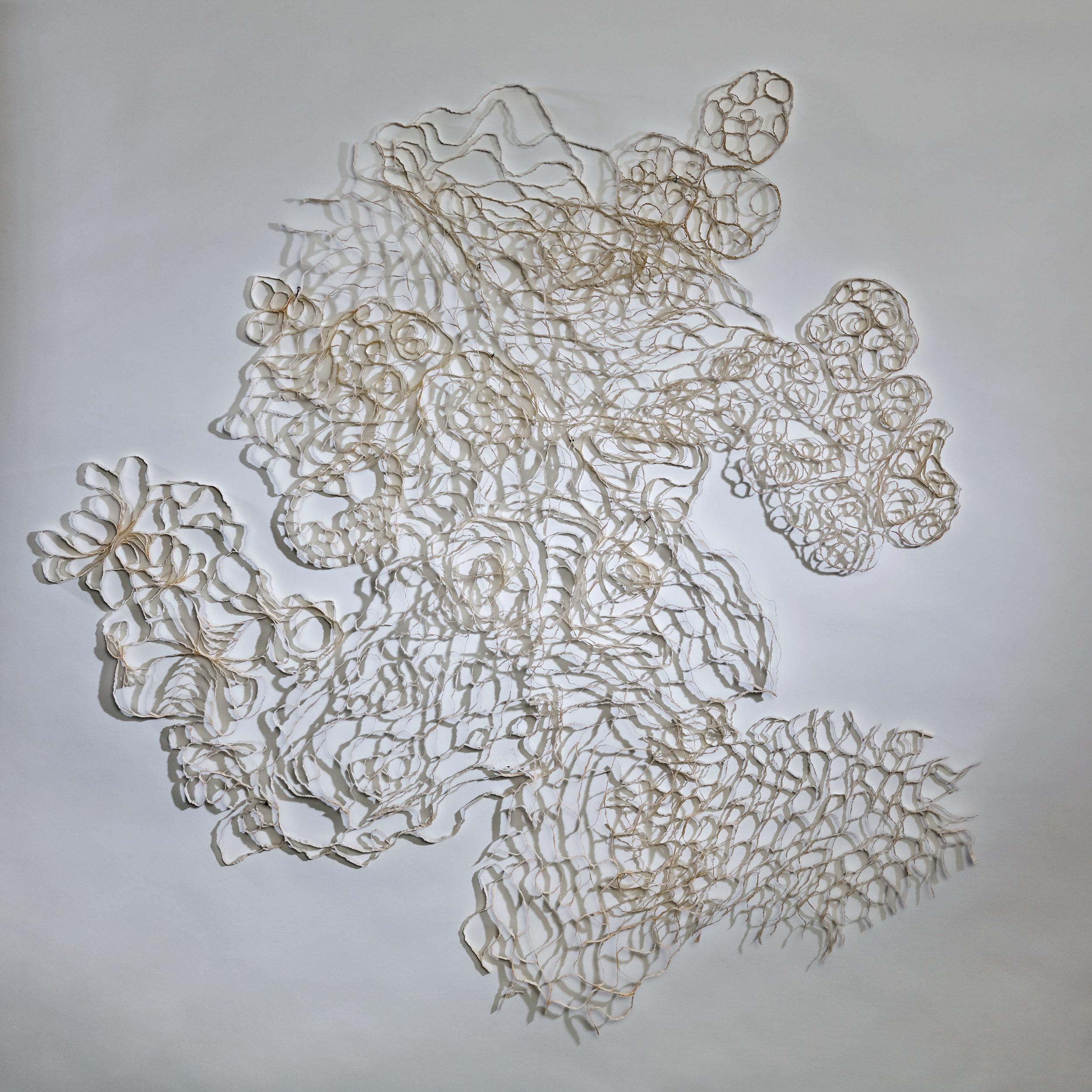 White Pattern Nine  (detail), 2012, paper, 34 x 82 x .25 in.