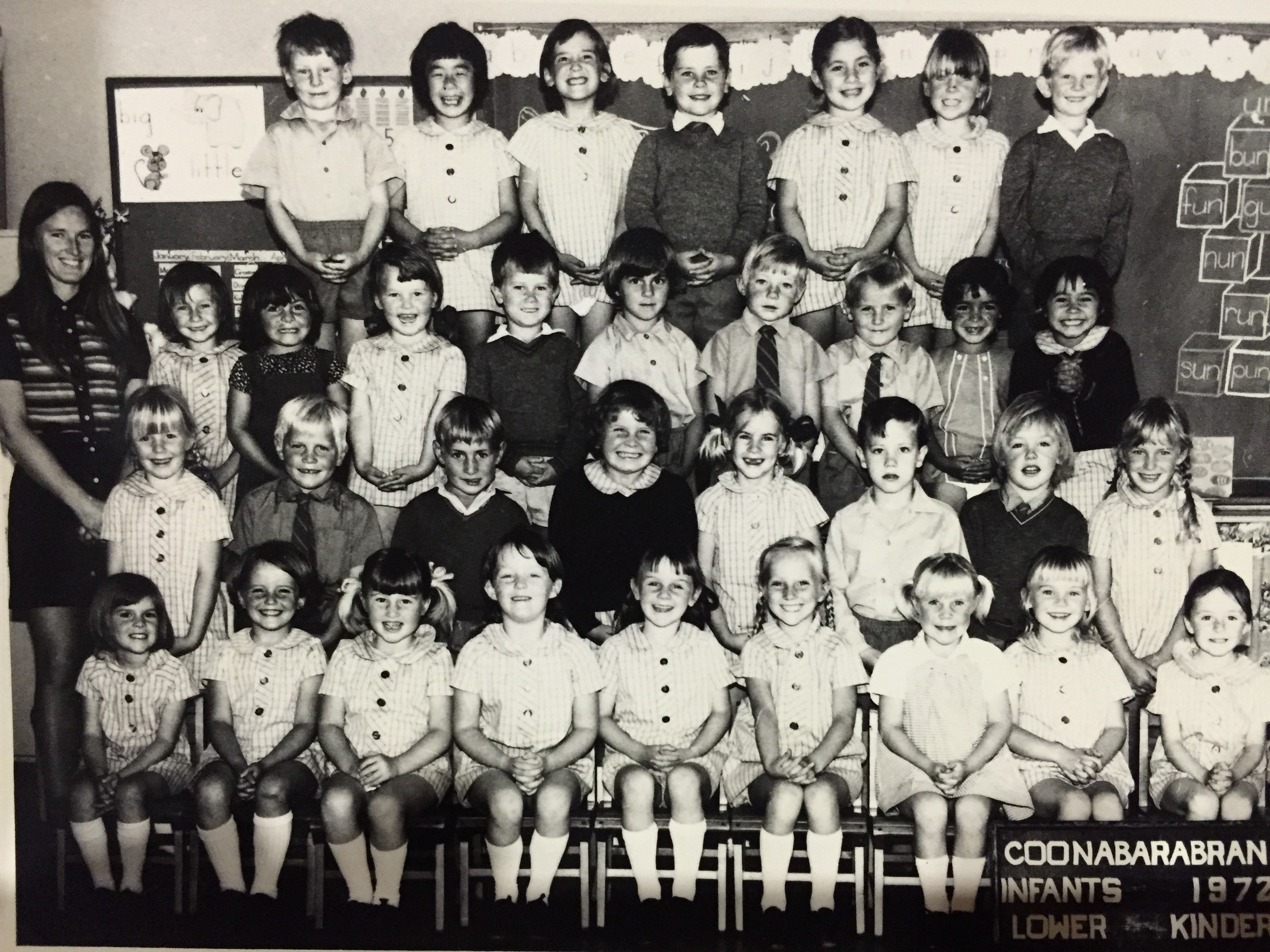 I'm afraid the black and white photo does NOT do justice to her extreme passion for colour co-ordination. I'm the girl with plaits, second row, far right.