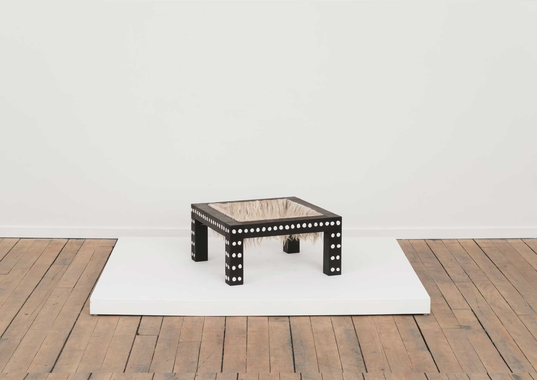 Soothe Table (Pacify) , 2015  Charred poplar, self-drying clay, alpaca  20 x 20 x 10 inches  Image courtesy of Volume Gallery, Chicago, IL