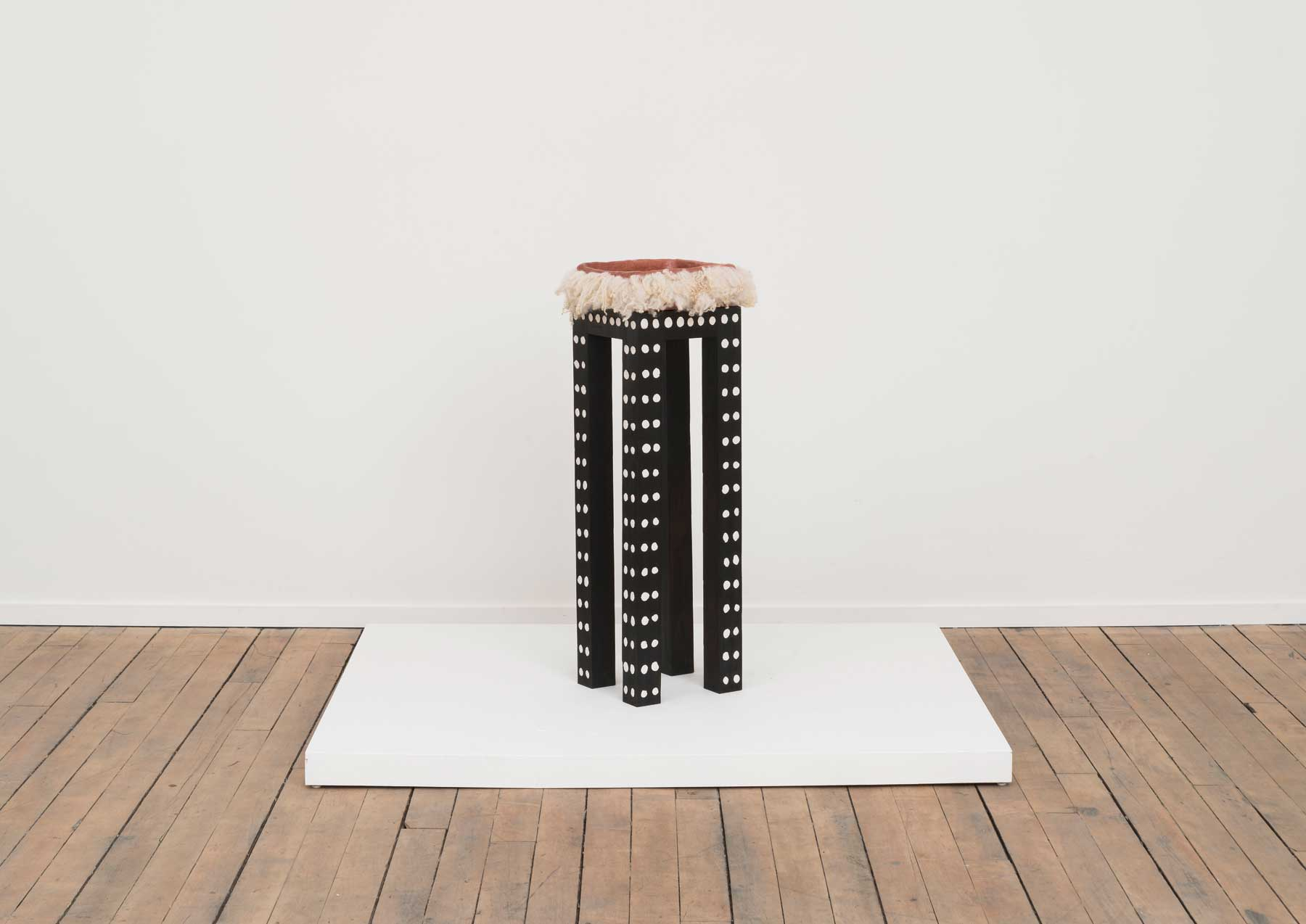 Soothe Table (Provide) , 2015  Charred poplar, self-drying clay, terra-cotta, wool  10 x 10 x 35.5inches  Image courtesy of Volume Gallery, Chicago, IL