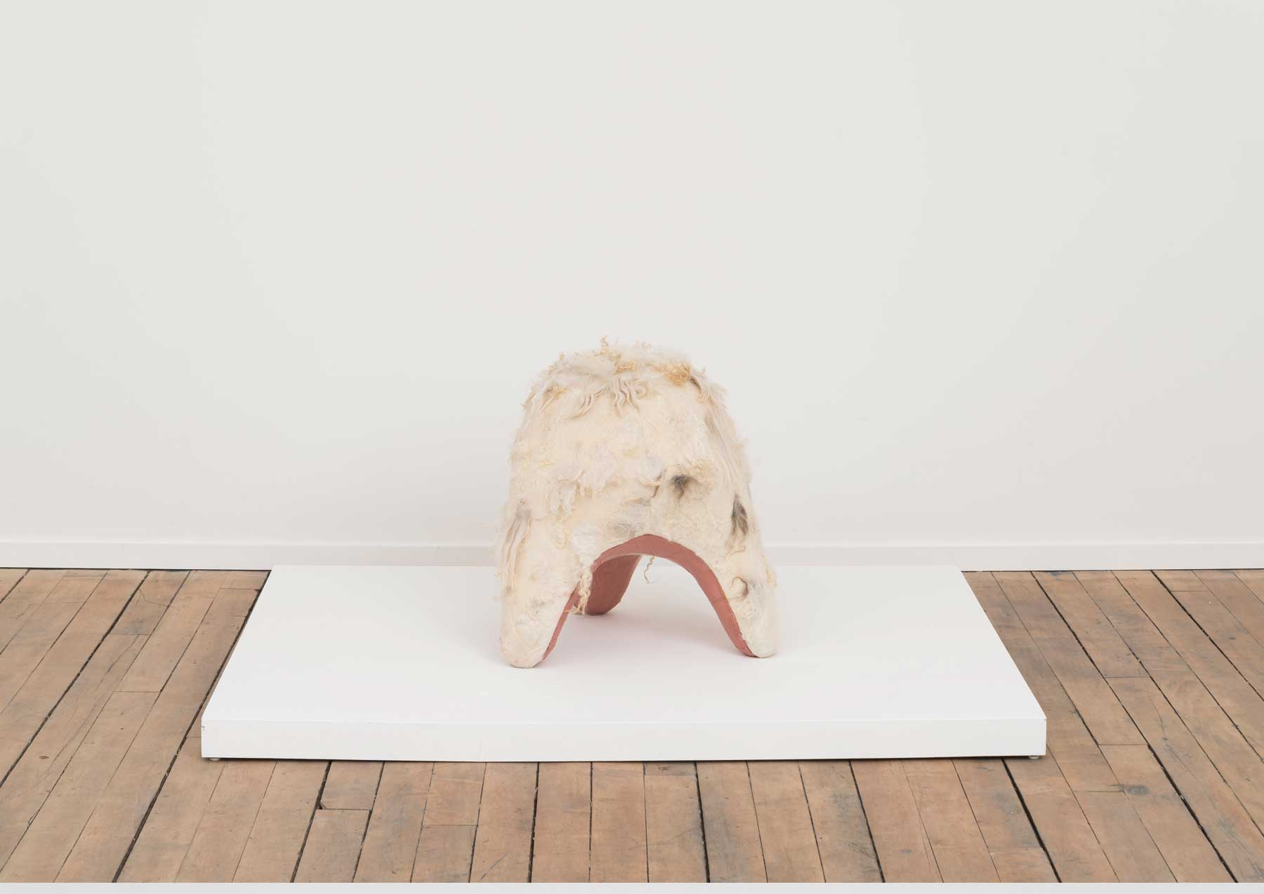 Swaddle Stool (Underbelly) , 2015  Self-dryingterra-cotta, canvas, wool  19 x 19x 20inches  Image courtesy of Volume Gallery, Chicago, IL
