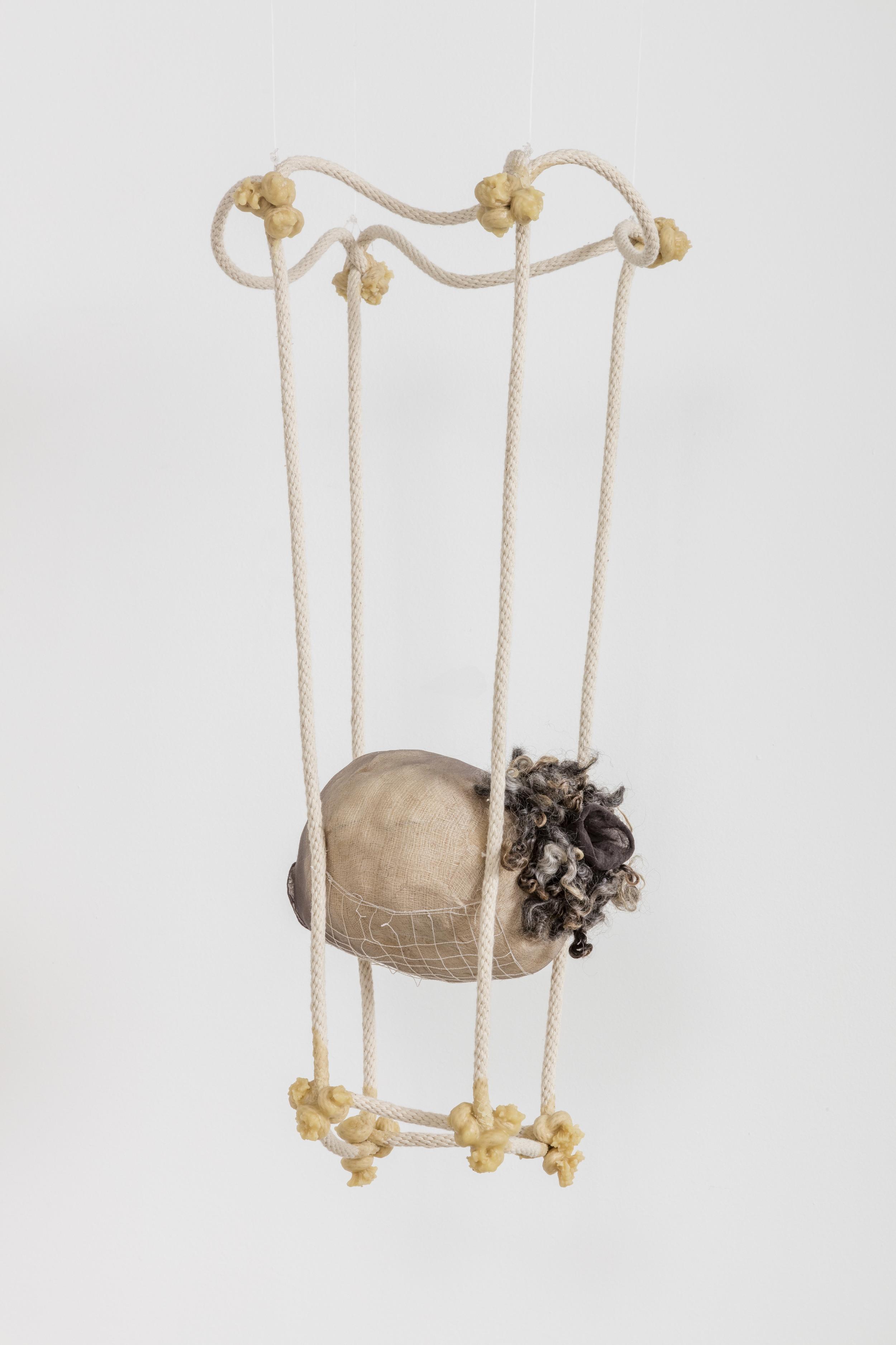 Tanya Aguiniga   Omission , 2016  Cotton rope, cotton thread, foam, gauze,nylon, wool, nylon and beeswax  24 x 10.5 x 8 inches