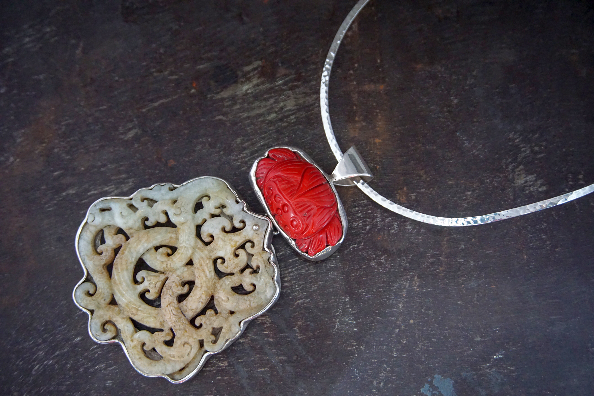 carved red coral pendant & white jade enhancer