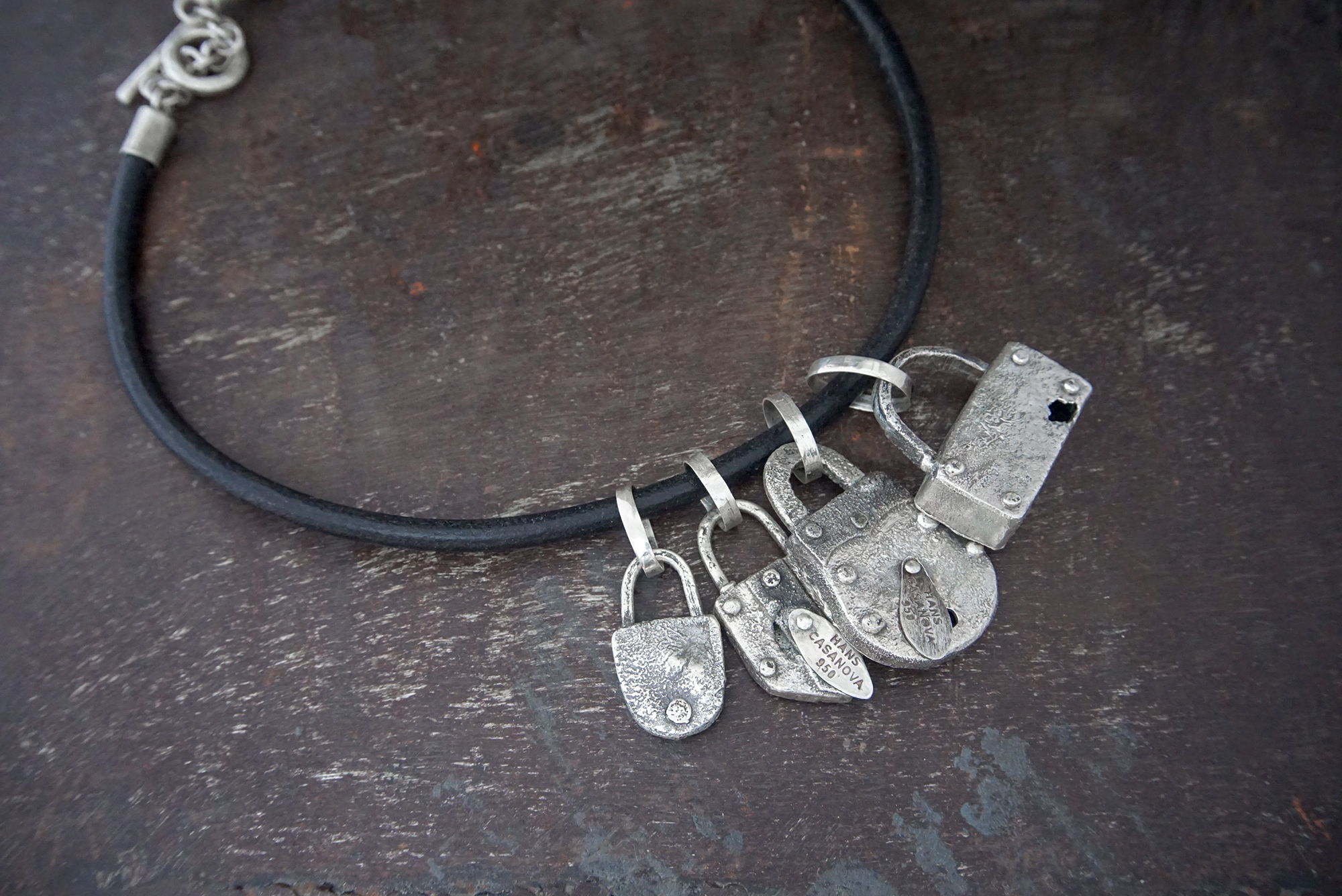 silver pendants on leather