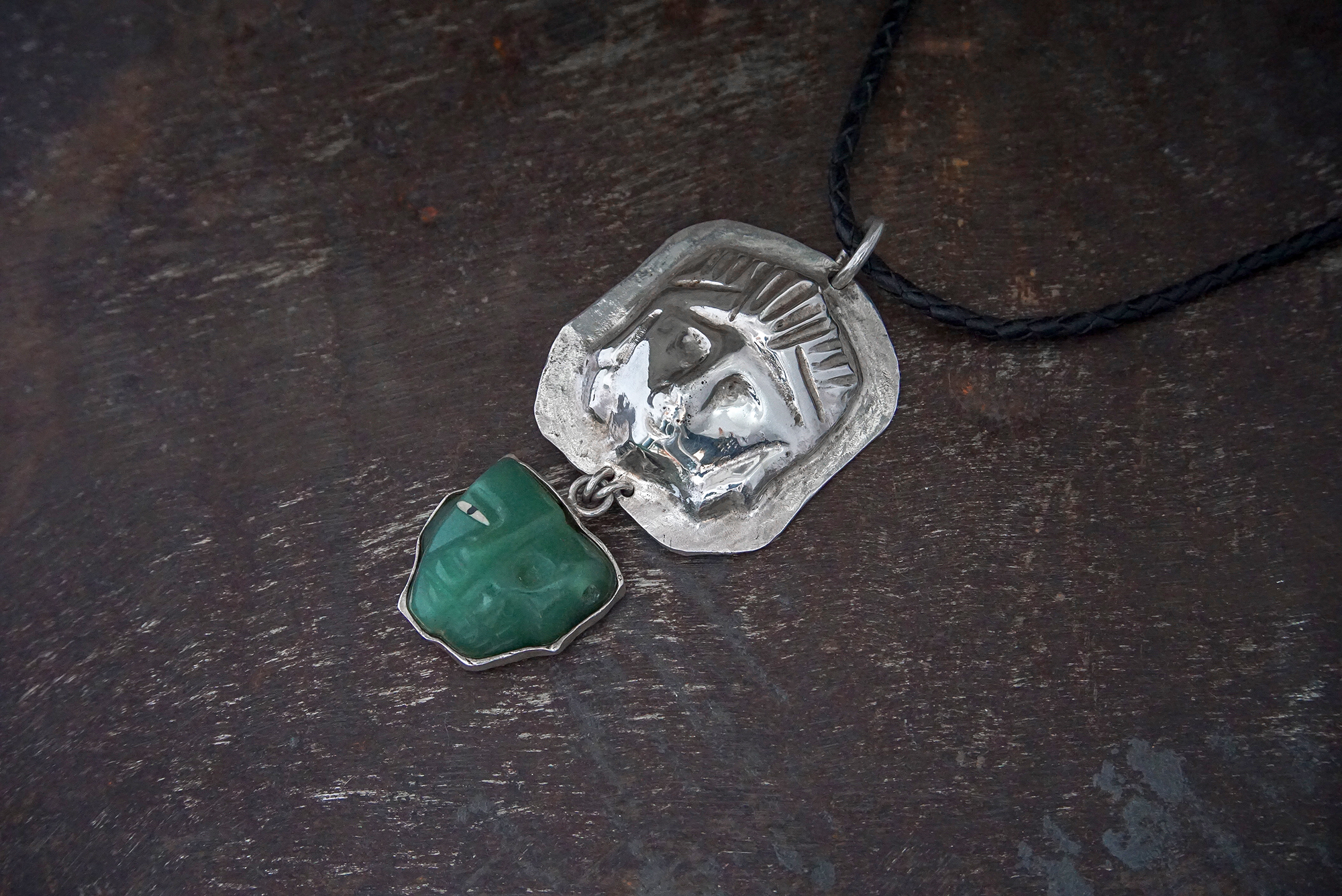 silver and carved jade pendant on leather
