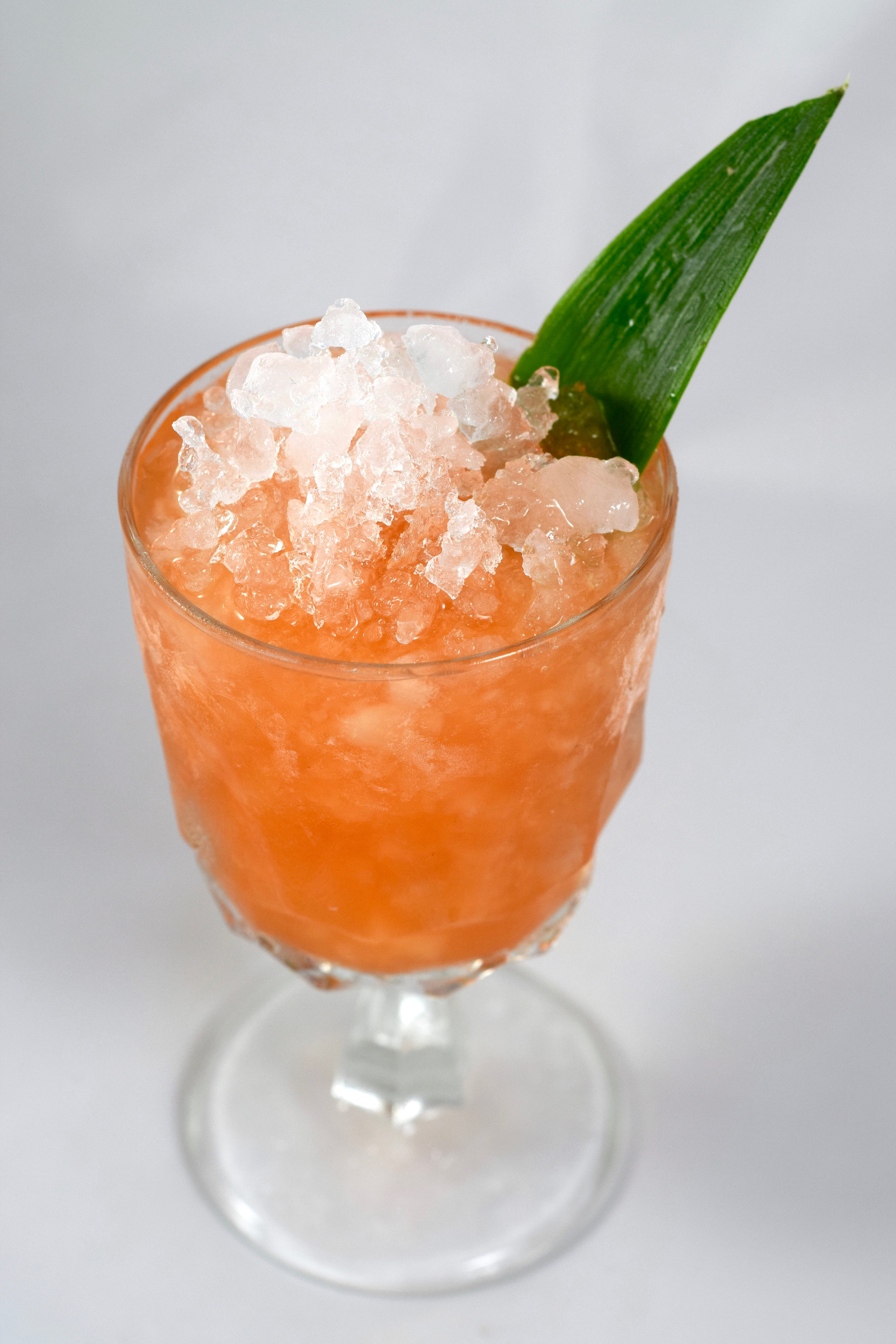 FLY SOUTH - 1 oz jamaican rum1 oz blackstrap rum1/2 oz campari1/2 oz nostrum pineapple turmeric ginger shrub3/4 oz lime juice1/4 oz cinnamon syrupShake with ice and strain.