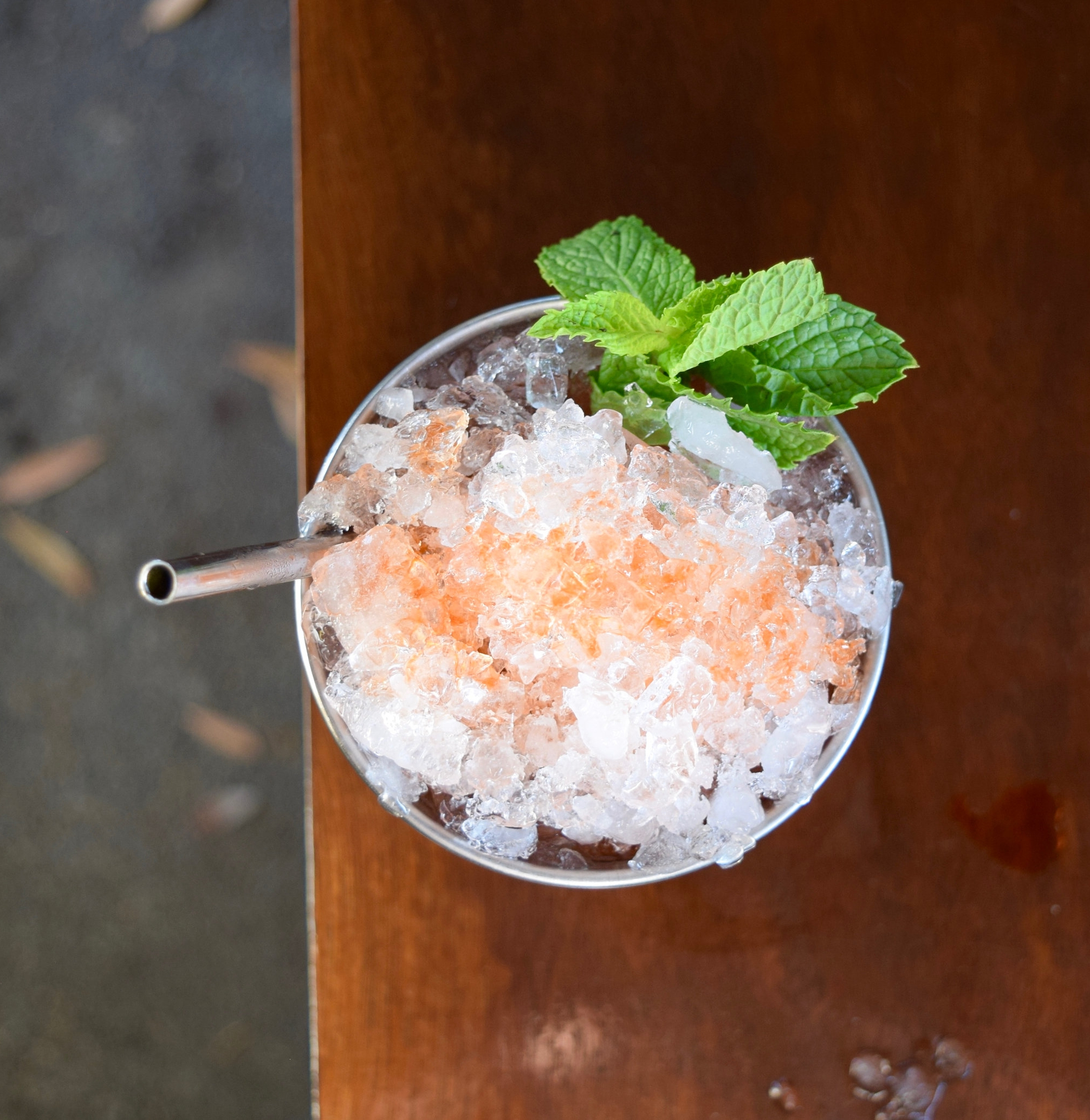 WHEN THE LEVEE BREAKS - 2 oz bourbon or rye whiskey1/2 oz nostrum pineapple turmeric ginger shrub1/2 oz fresh lemon juice1/4 oz demerara syrup8 mint leaves2 dashes angostura bittersShake with ice and strain. Top with bitters.
