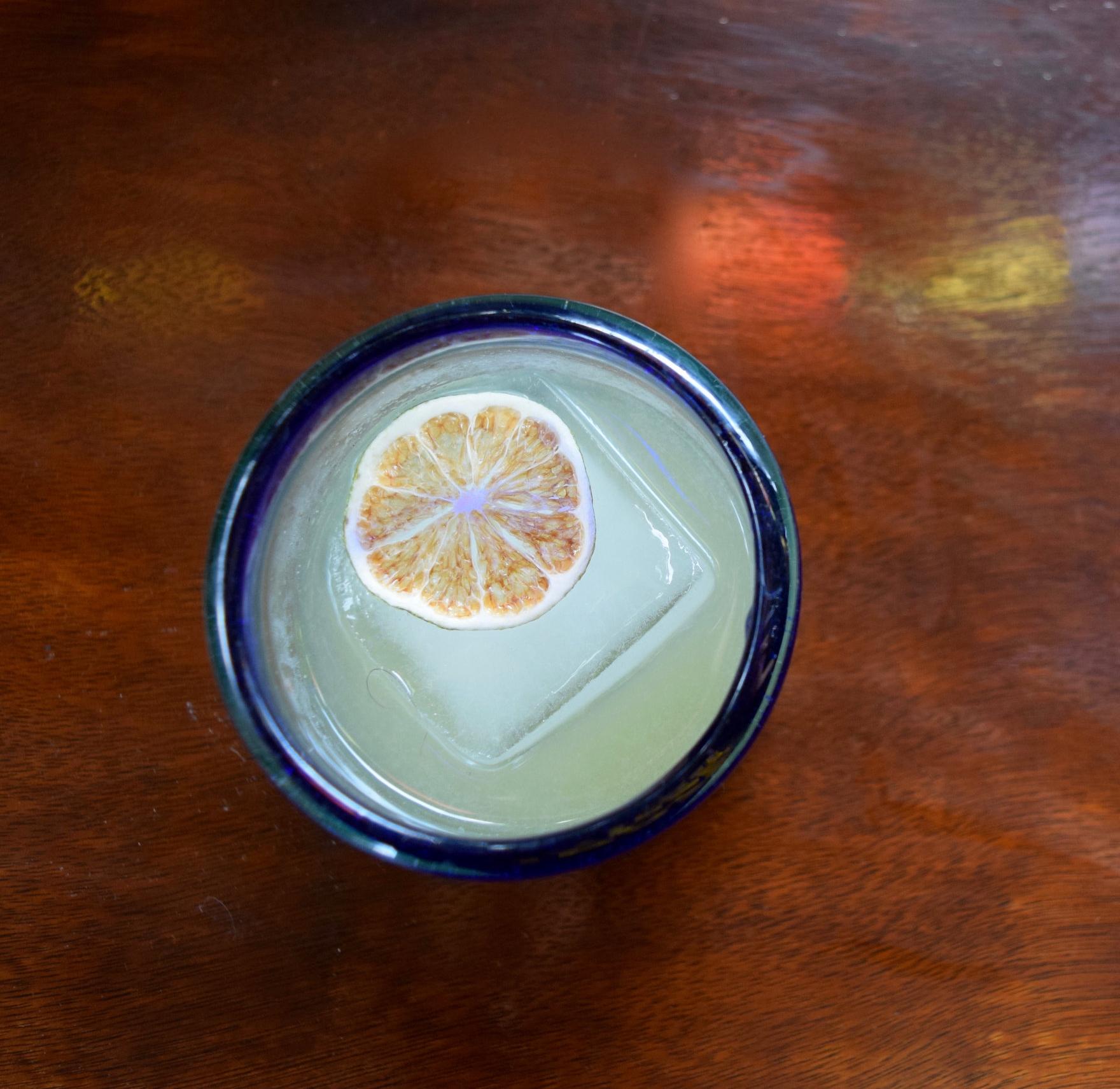 FLOWER WAR - 1 oz gin1 oz ancho reyes verde liqueur1/2 oz nostrum kumquat lemongrass lime leaf shrub1 oz lime juiceShake with ice and strain.
