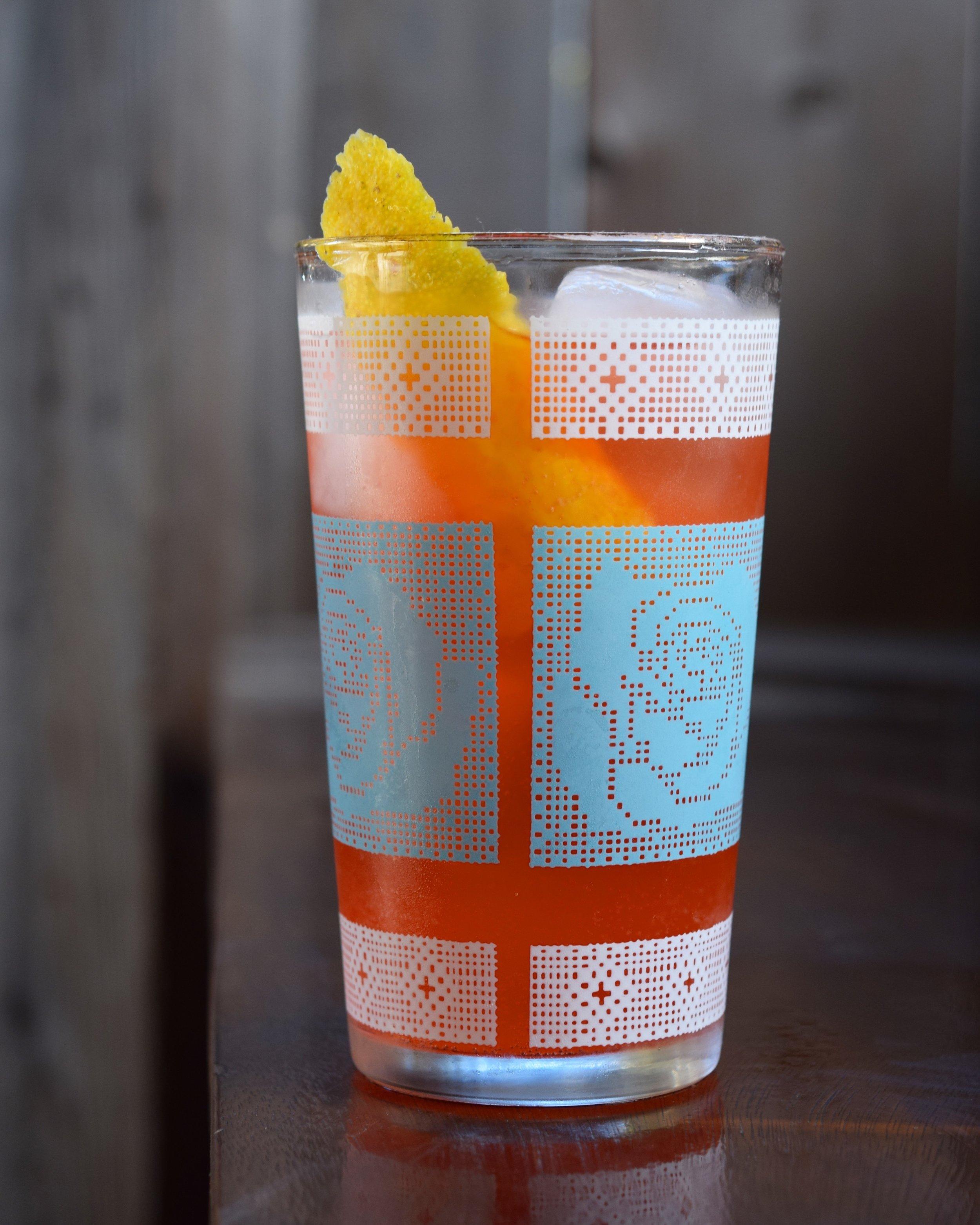 LAYOVER - 1.5 oz gin1/2 oz campari1/2 oz nostrum pineapple turmeric ginger shrub1/2 oz lemon juice2 oz soda waterBuild over ice.