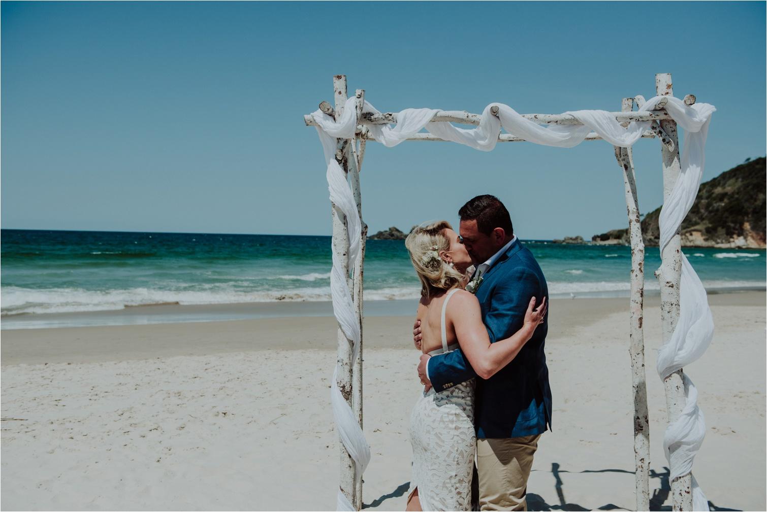 First kiss at byron bay beach wedding