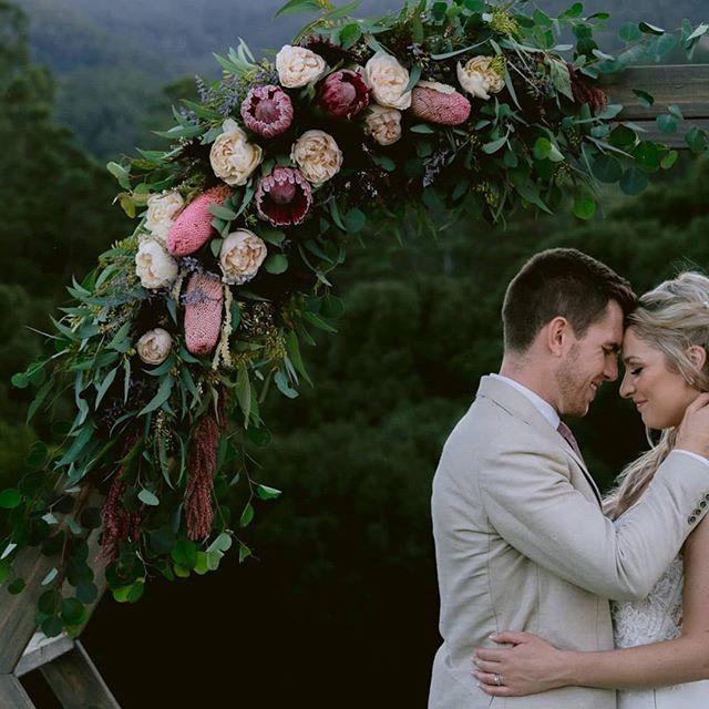 Love this image in B&W but the colour version shows off the stunning florals!! #sharingboth ⠀⠀⠀⠀⠀⠀⠀⠀⠀ Britt & Alex ❤️ Venue - @mavises_kitchen Gown - @pronovias from @whitelilycouture Florist - @hartandflowers Celebrant - @byronbayweddingcelebrant Makeup & Hair - @lady_bella_australia Band - @thewhitetree . . . #blackandwhiteorcolour  #maviseskitchen #maviseskitchenwedding #maviskitchen #ukinsw #goldcoastwedding #ceremonyarbour #blackandwhiteweddingphotography #bnwmood #bnwphotography #love_bnw #madlydeeply  #tweedcoastwedding #pronovias #pronoviasbride #WhiteLilyBride #PronoviasStylishBride #wedding  #theuniquebride #elegantbride #weddingstyle #weddingflowers #goldcoastweddingphotographer #mtwarningweddingvenue #northernnswweddings #weddinginspo #dreamwedding #ohwowyes